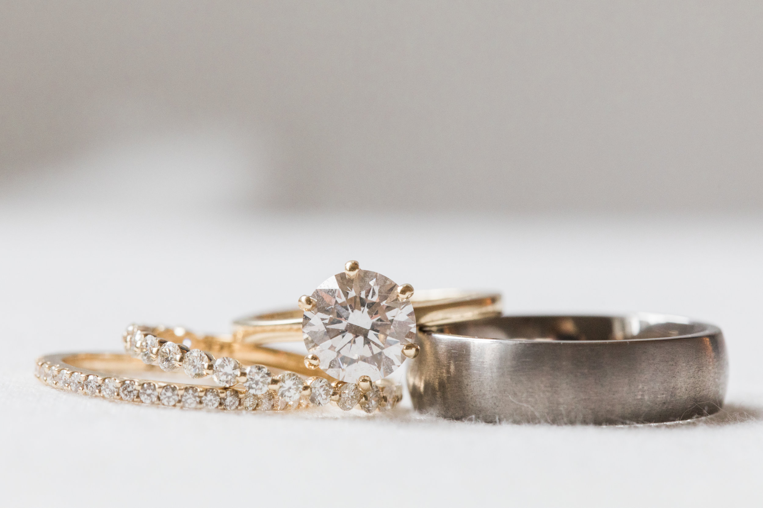 Classic, gold engagement ring and wedding bands.