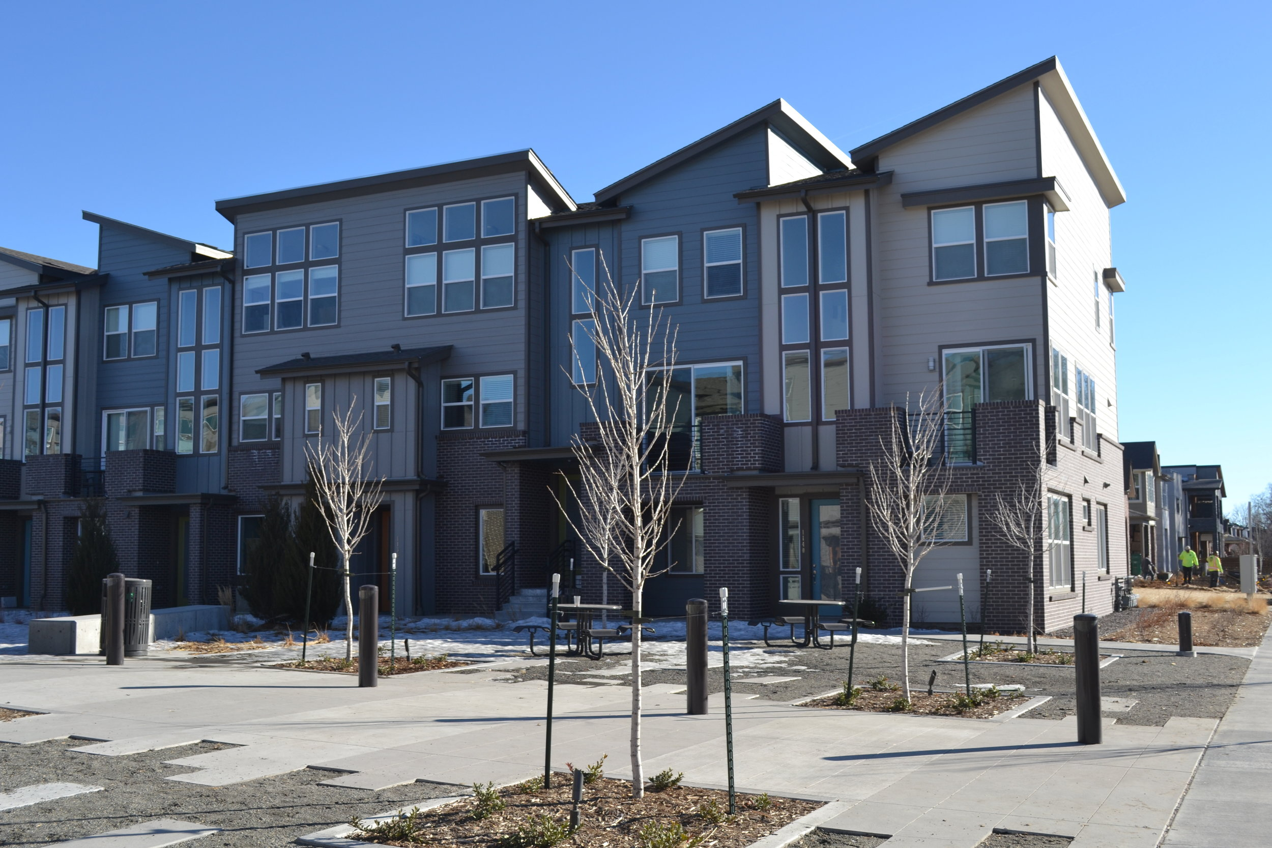 New Town Homes at the former Gates Rubber factory site on land previously zoned Industrial that STARBOARD rezoned to Transit Mixed Use Zoning, enabling new infill development.