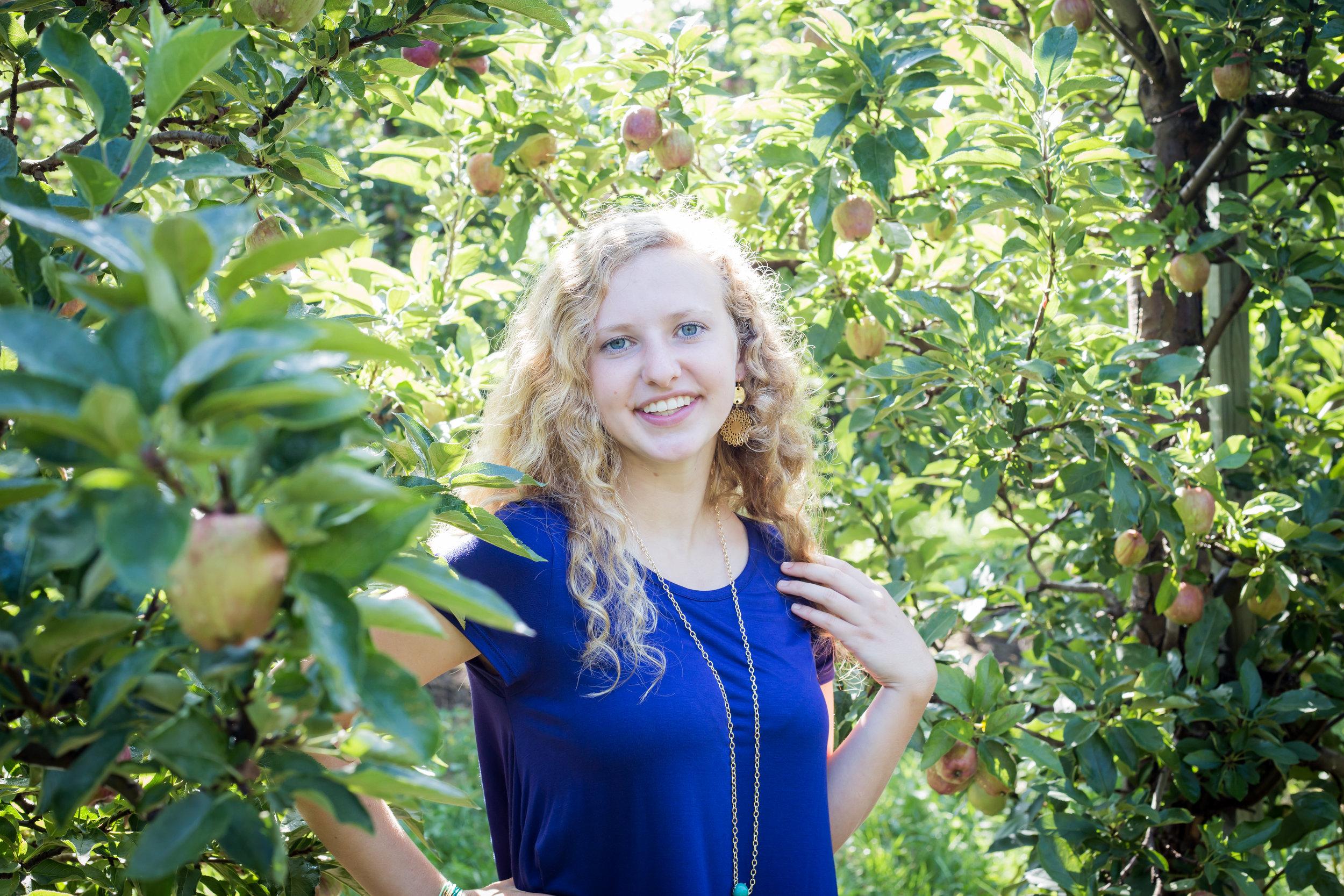 Michigan apple orchard senior blue top blond hair