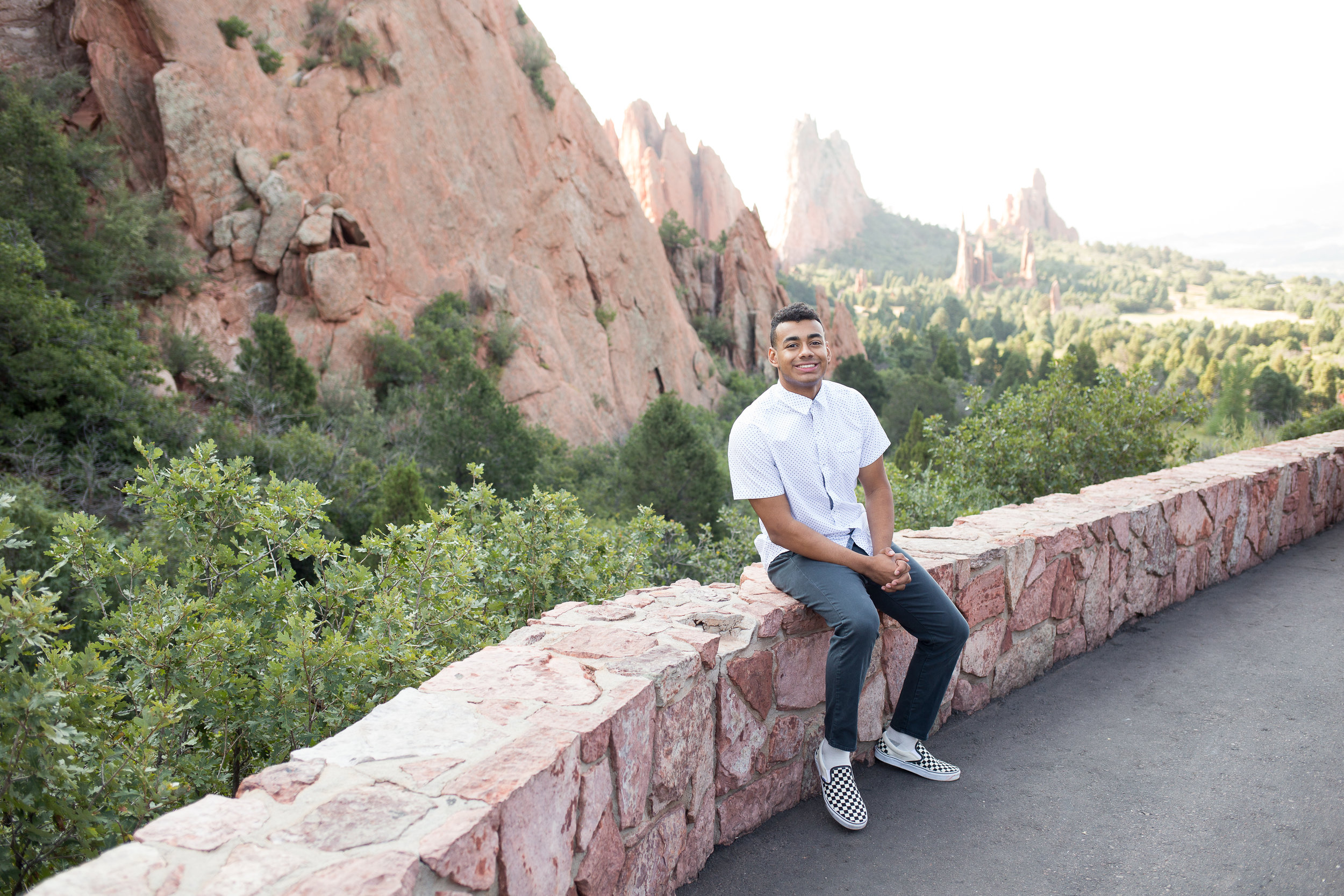 Liberty High School  Senior sitting on rock wall in front of scenic Garden of the Gods,  Stacy Carosa Photography, Colorado  Springs seniors