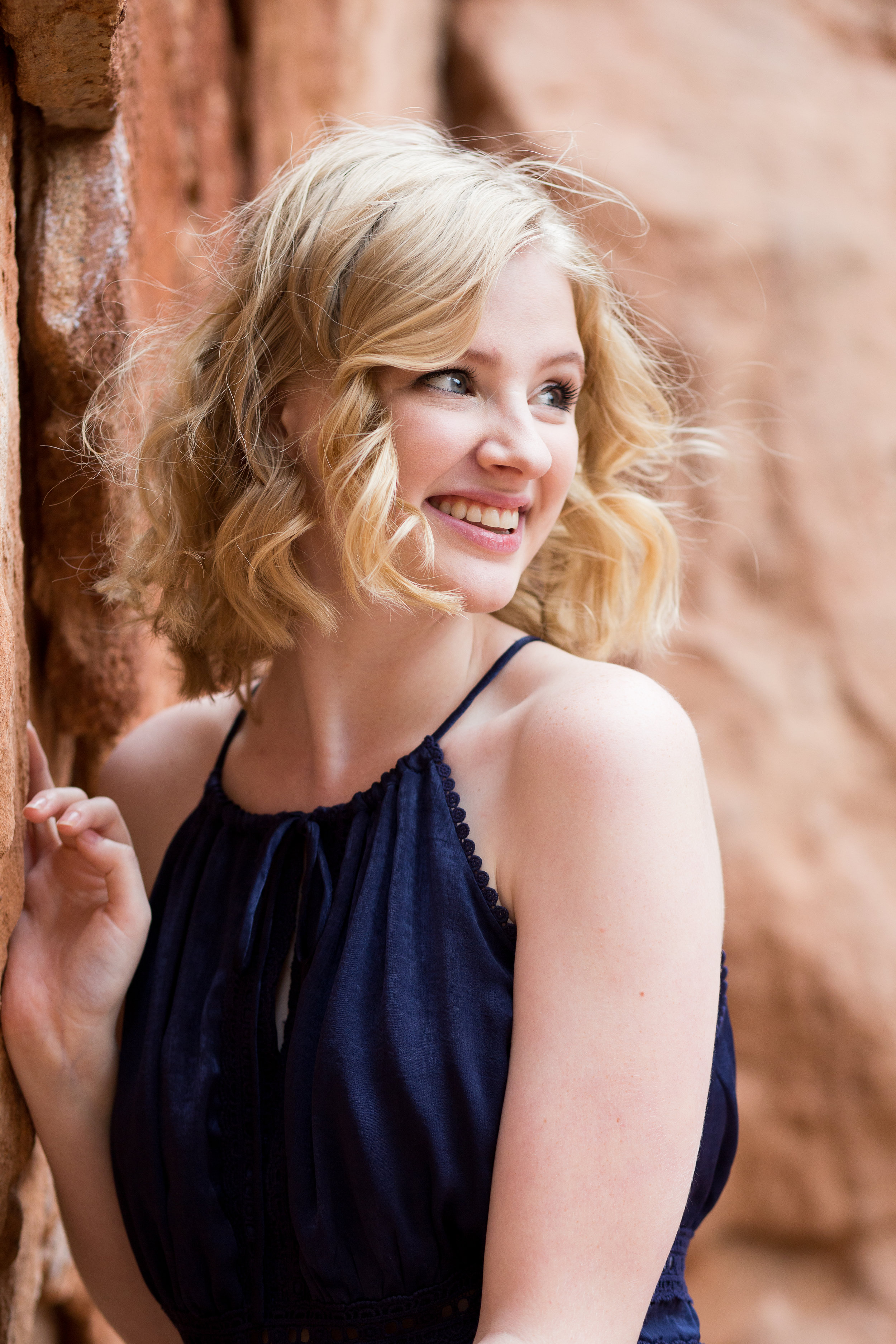 Girl laughing and looking in the distance, headshot with soft natural light for her senior session, Stacy Carosa Photography, Colorado Springs