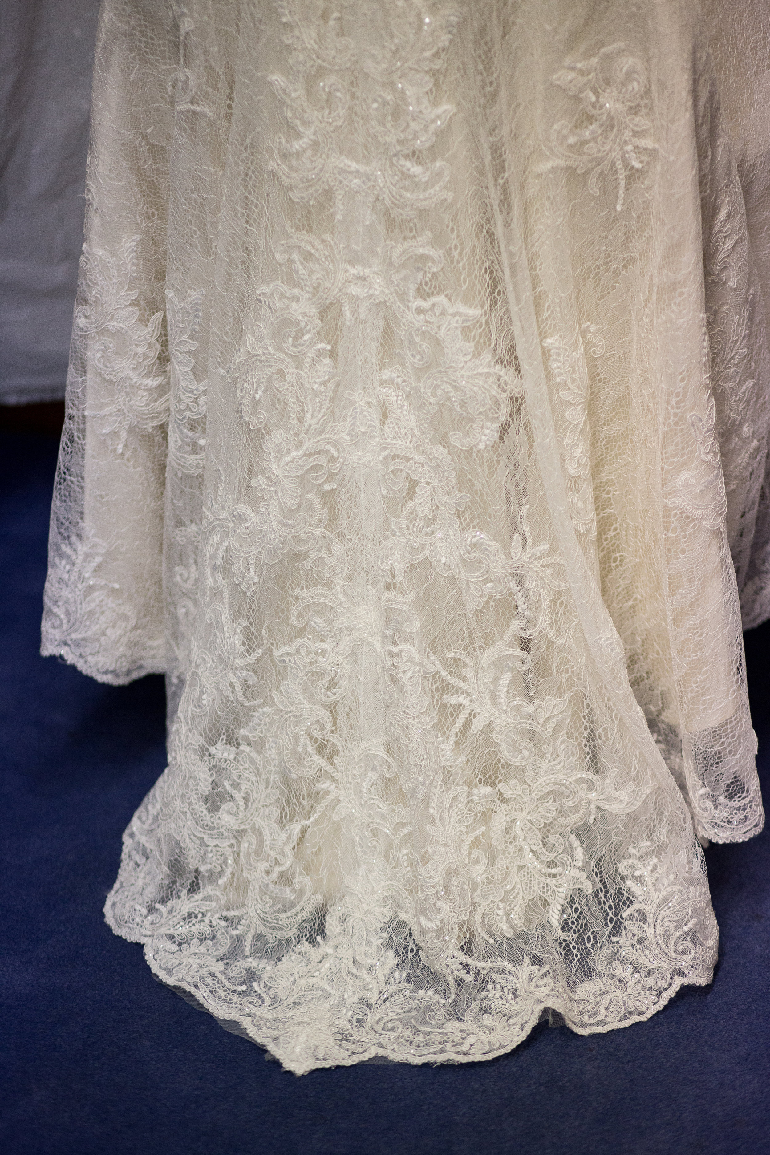Long lace bridal gown for wedding in Colorado Springs at First Baptist Church Stacy Carosa Photography