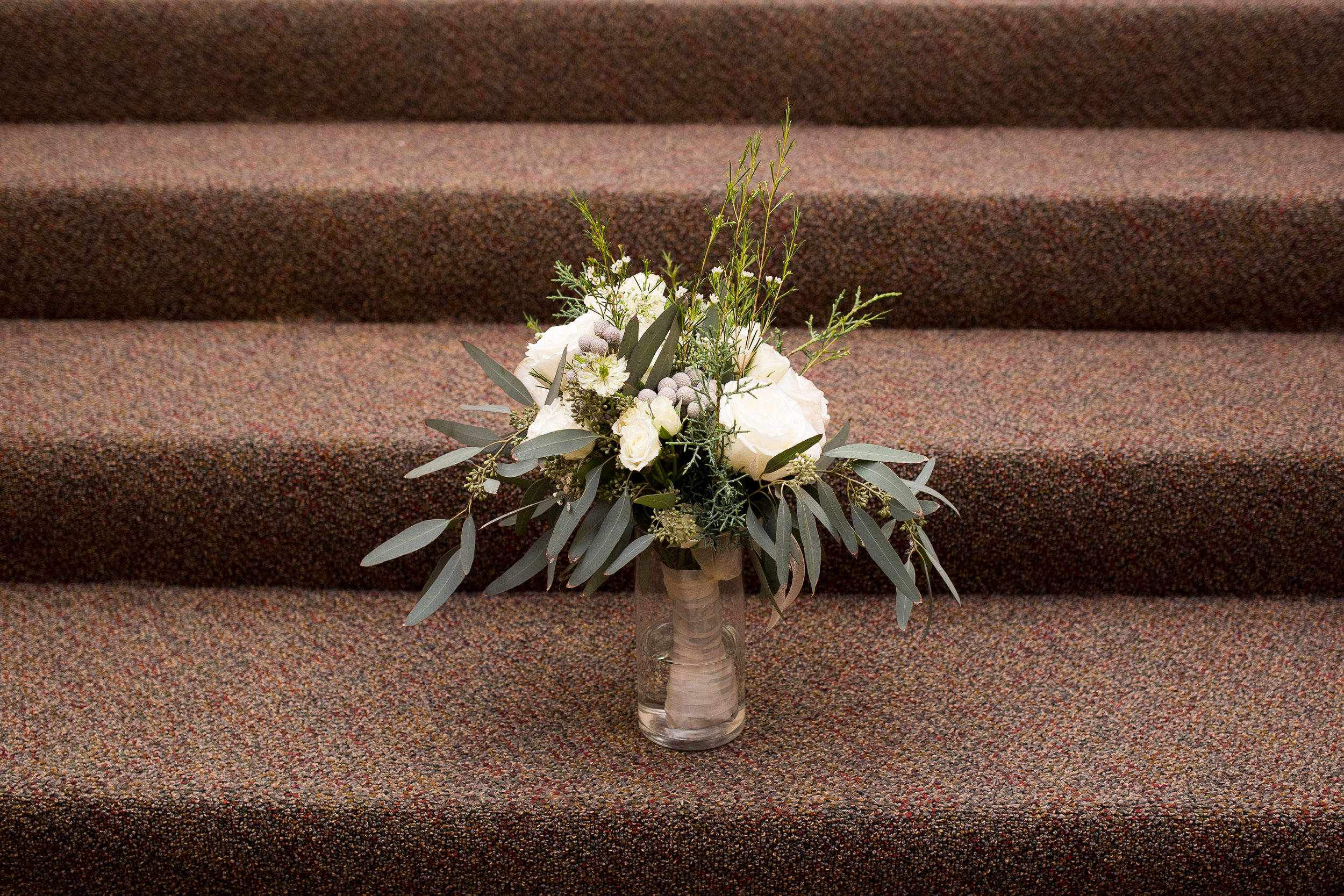 White flowers and eucalytus bouquet in Colorado Springs Winter Wedding Stacy Carosa Photography
