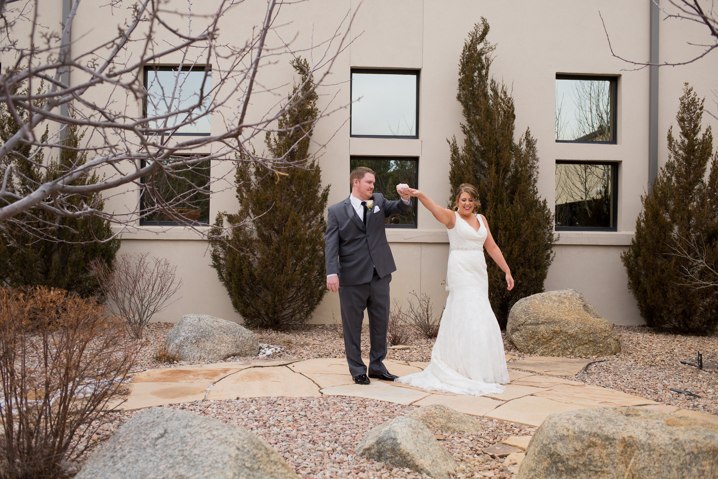 Wedgewood at Black Forest Winter Wedding of a couple's first look outside of the reception area. Groom twirling bride around Stacy Carosa Photography
