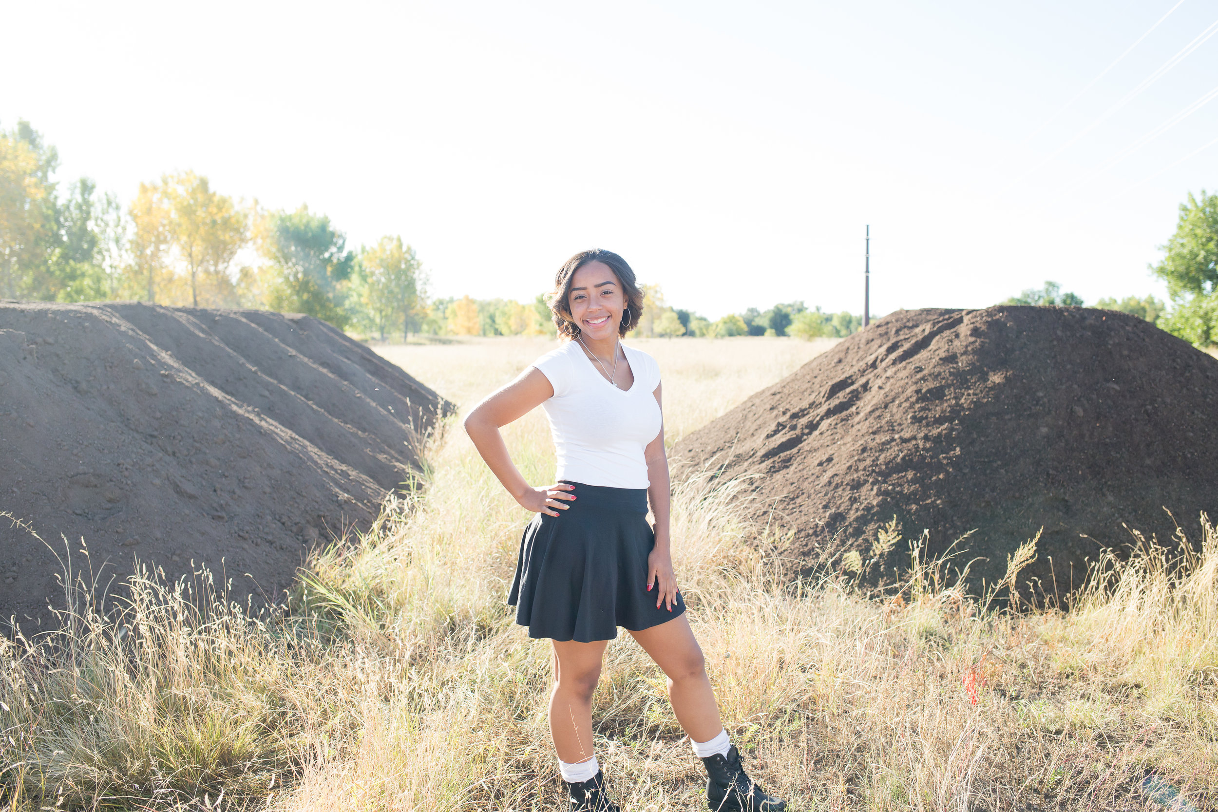 Senior girl standing among the landscape at Fountain Creek Regional Park in Colorado Springs, CO Stacy Carosa Photography