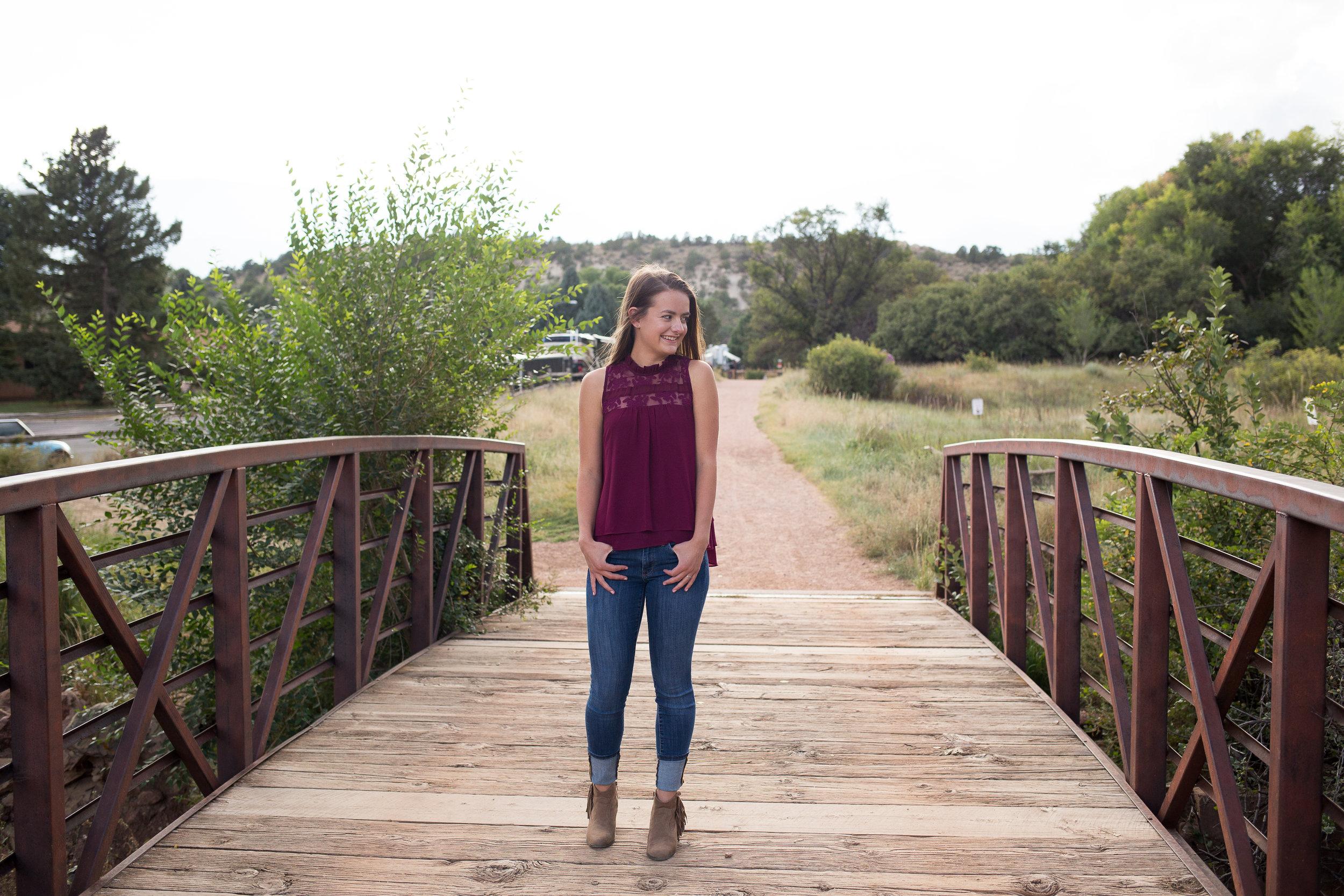 Colorado Springs Senior Photographer Stacy Carosa Photography Rock Ledge Ranch Senior Photos Session girl standing on bridge