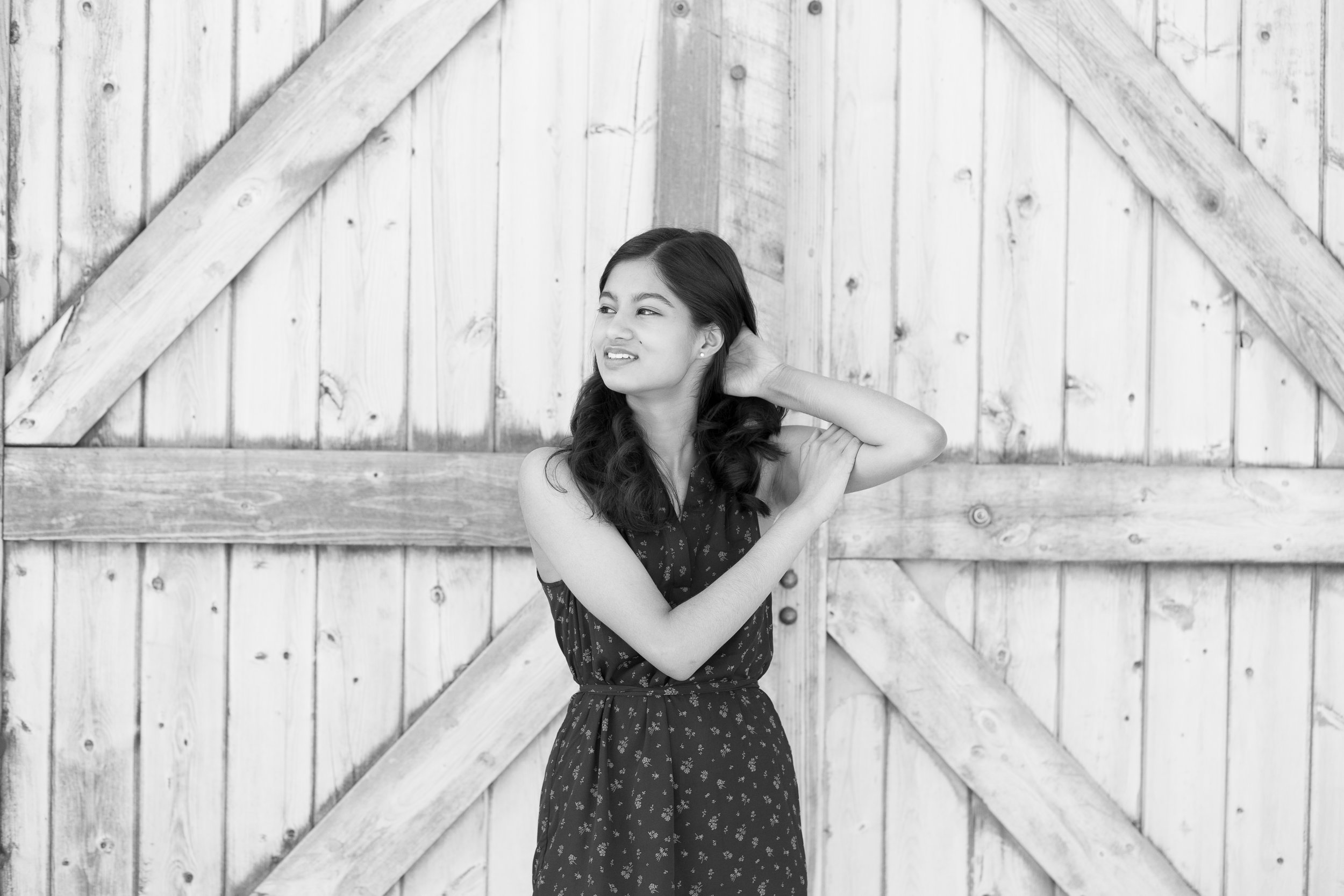 Girl posing in front of barn at Rock Ledge Ranch for her senior photos Stacy Carosa Photography Colorado Springs Senior Photographer Session at Rock Ledge Ranch