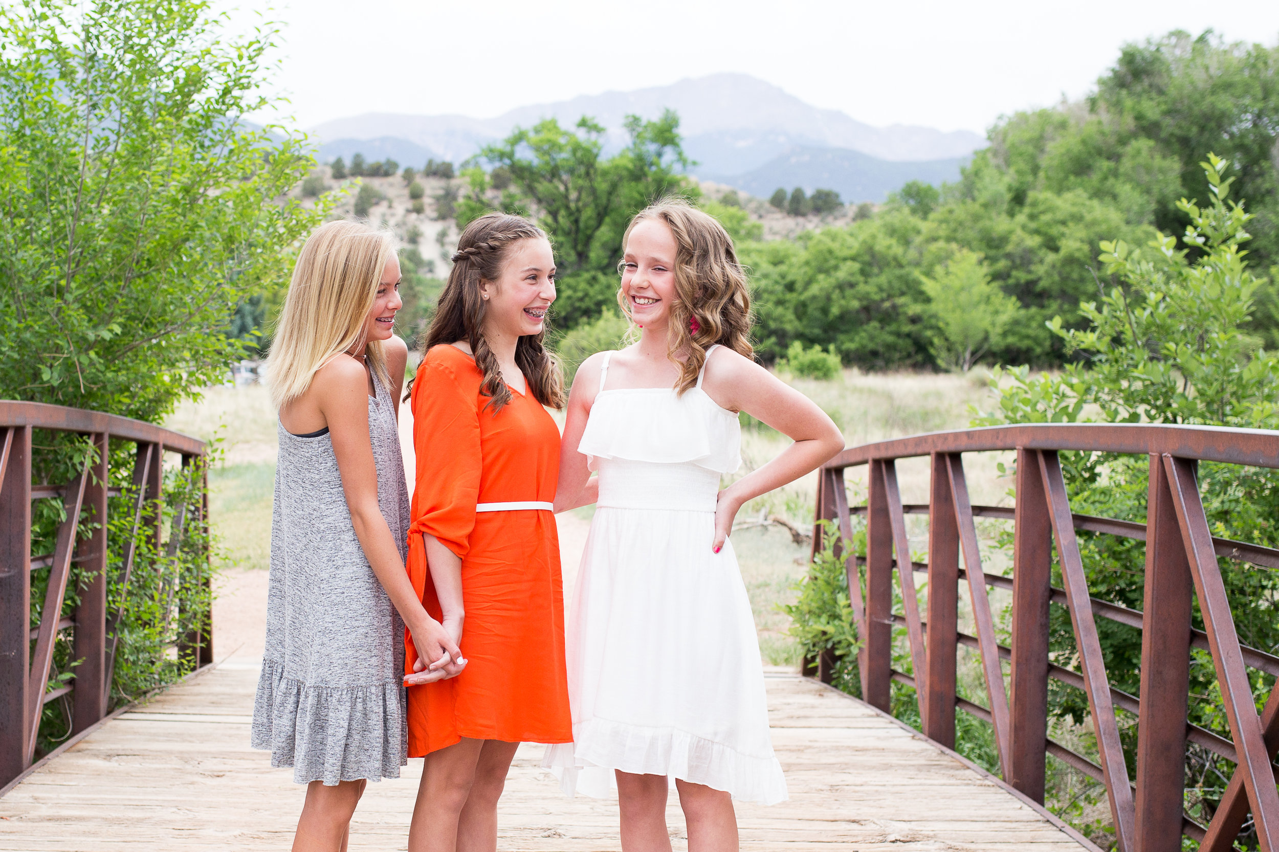 Colorado Springs Senior and Tween Photographer | Colorado  Springs Tween and Senior Photography | Stacy Carosa Photography | Middle School friends standing on a bridge