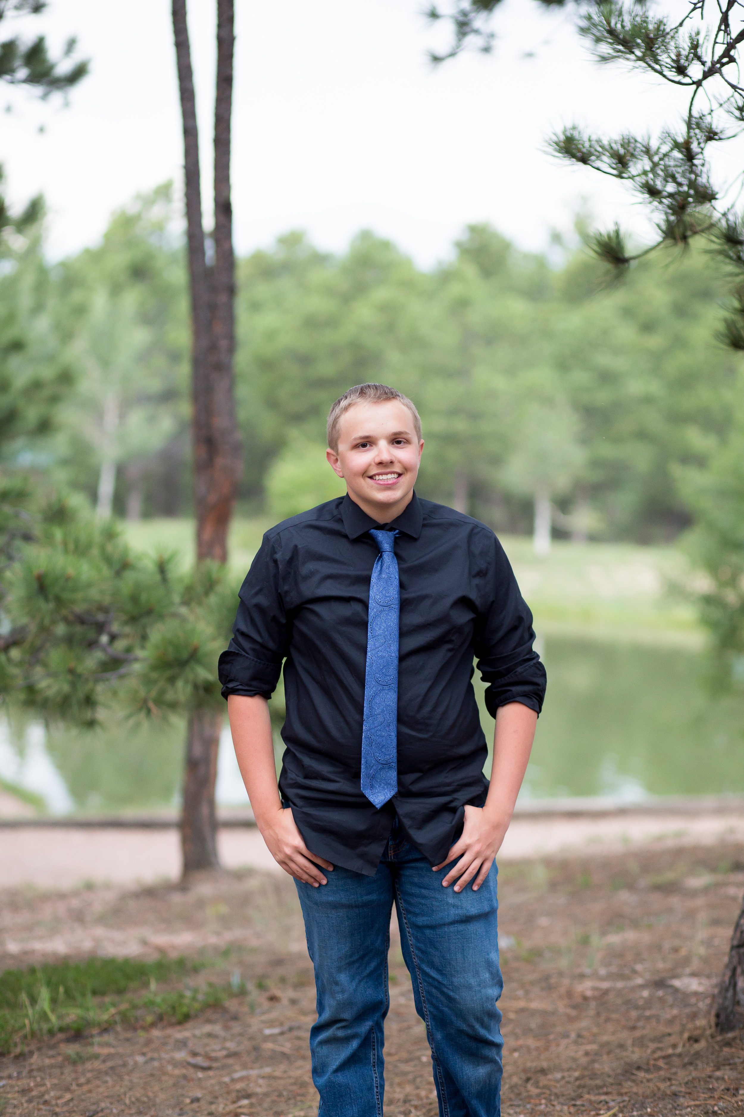 Colorado Springs Senior Photography | Stacy Carosa Photography | Colorado Springs senior photographer | senior session at Fox Run Park | Widefield high school senior among pine trees