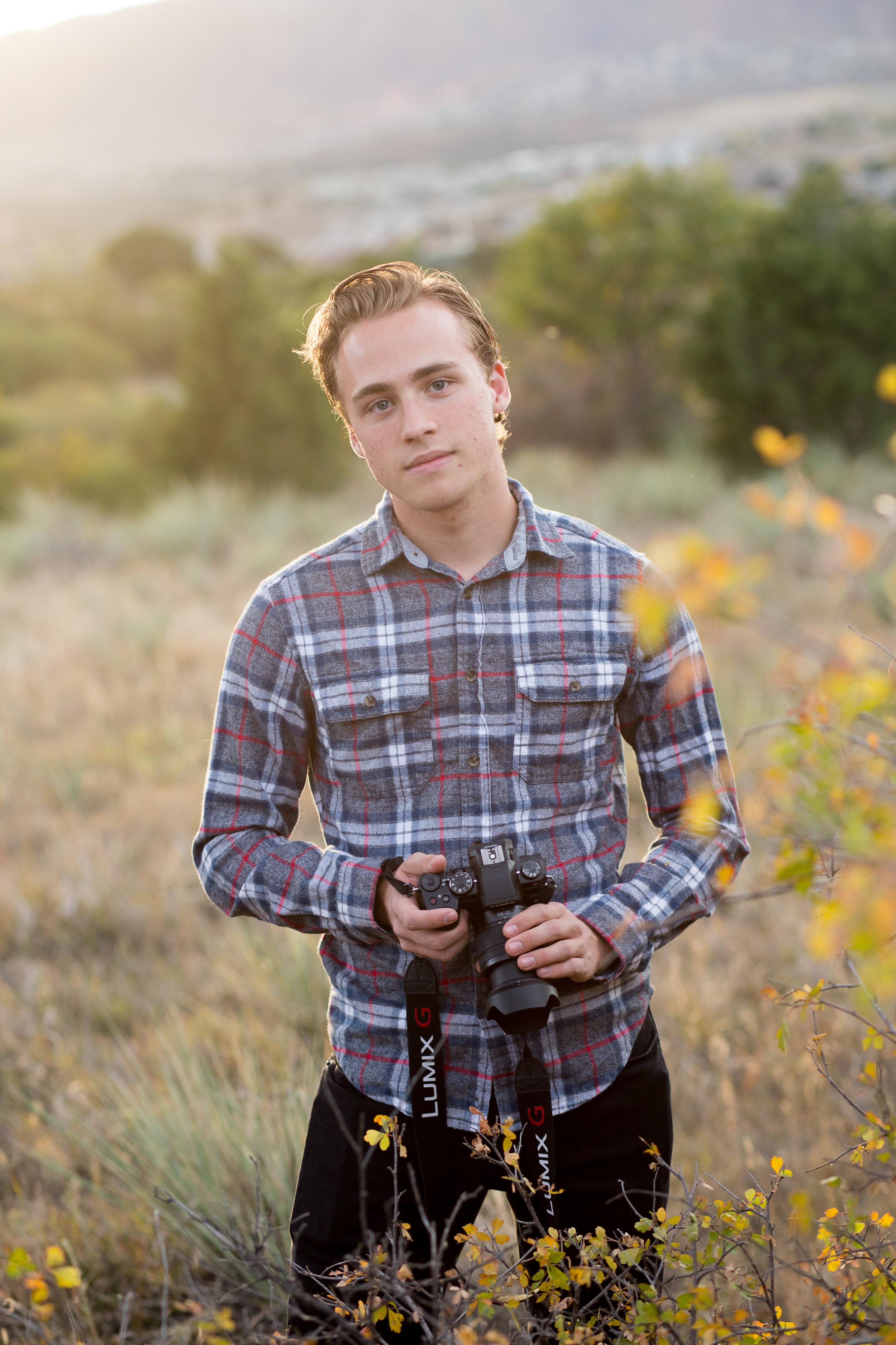 Senior boy standing in field | Colorado Springs Senior Photography | Colorado Springs Senior Photographer | Stacy Carosa Photography | Colorado Senior Portraits | Doherty High School