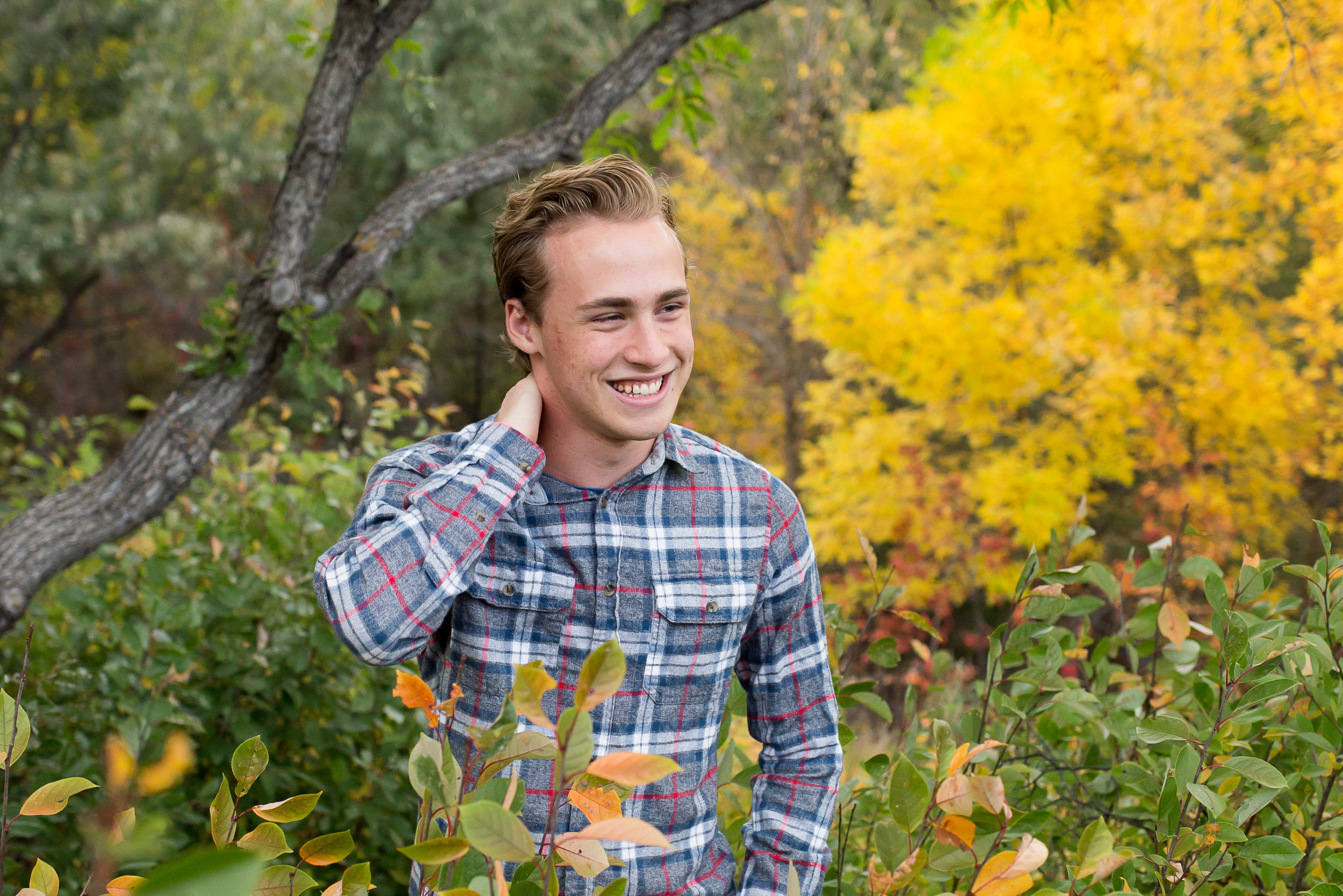 Senior boy from Palmer High School standing by fall colors | Colorado Springs Senior Photography | Colorado Springs Senior Photographer | Stacy Carosa Photography | Colorado Senior Portraits | Doherty High School