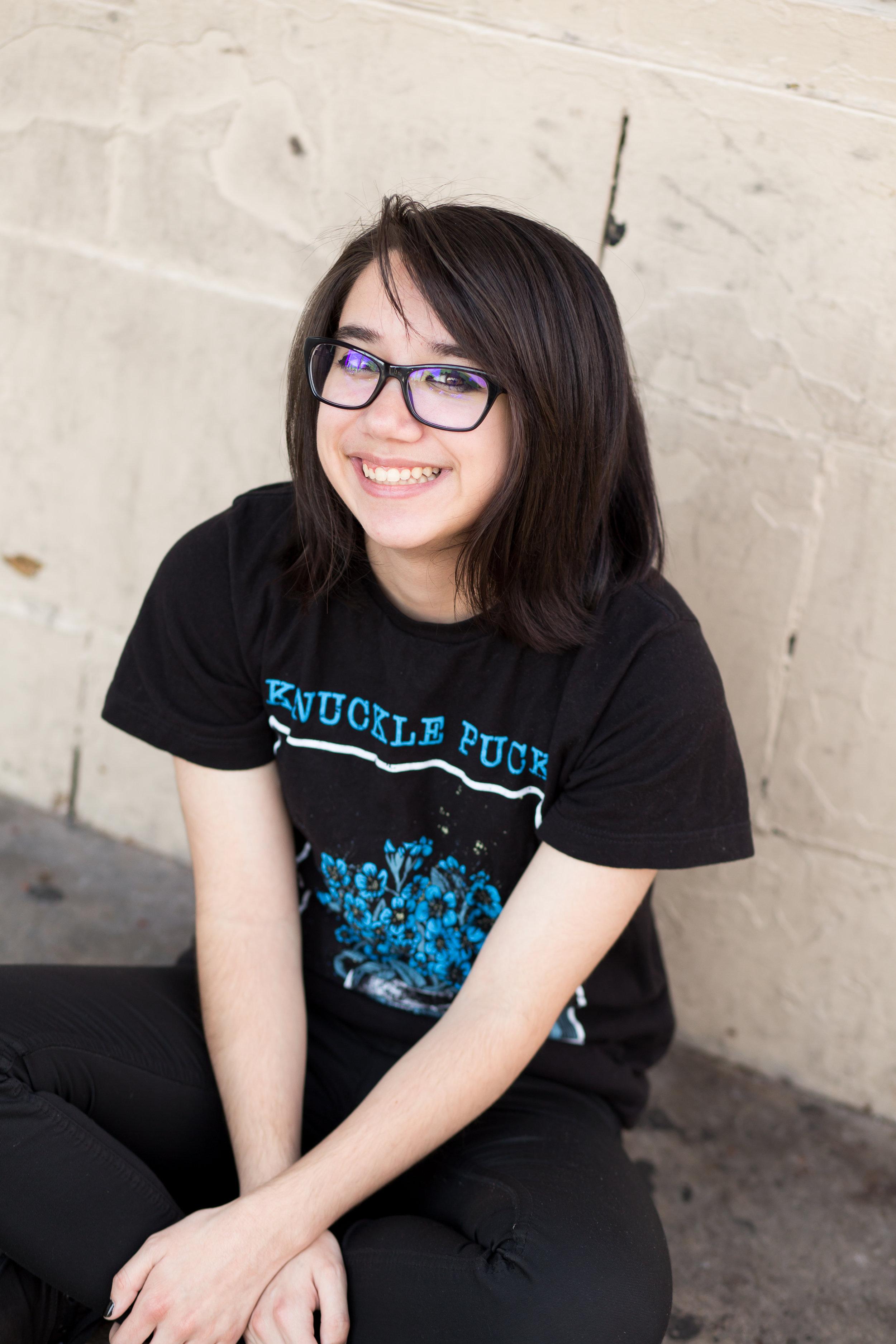 Colorado Springs Senior Photography | Colorado Springs Senior Photographer | Girl in black shirt smiling at camera | Stacy Carosa Photography