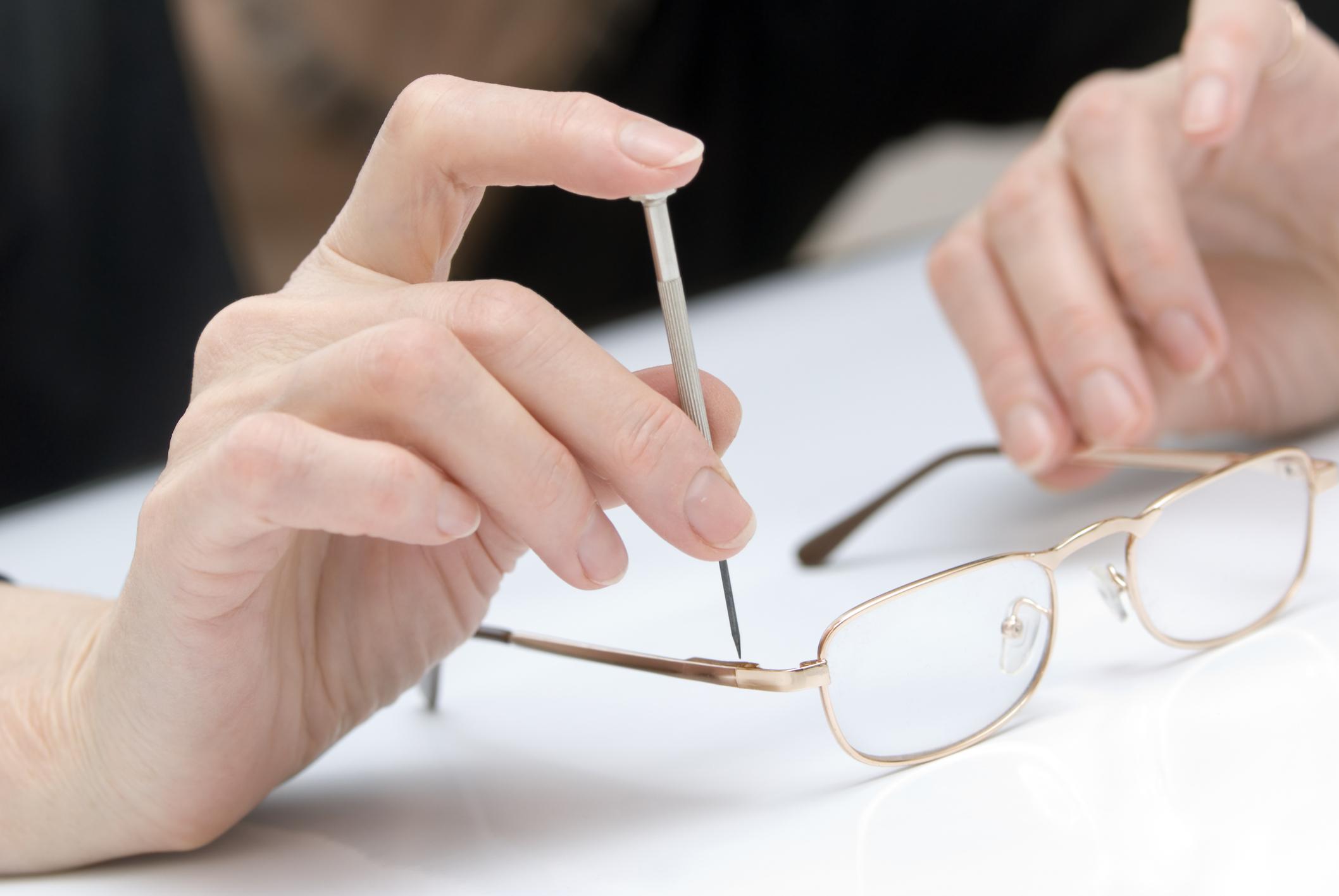 Adjusting and repairing eyeglasses frames.