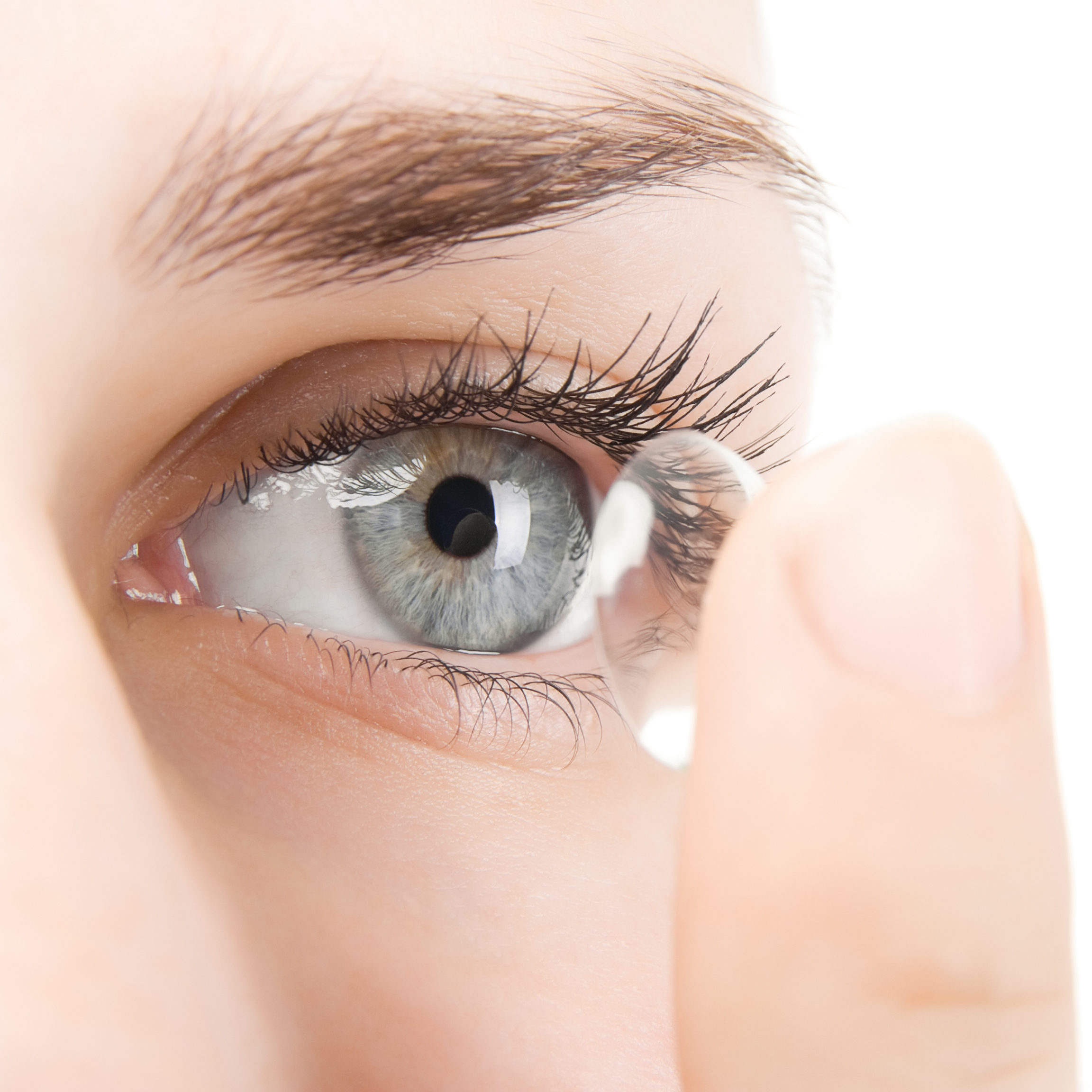 Inserting contact lenses on the eye.