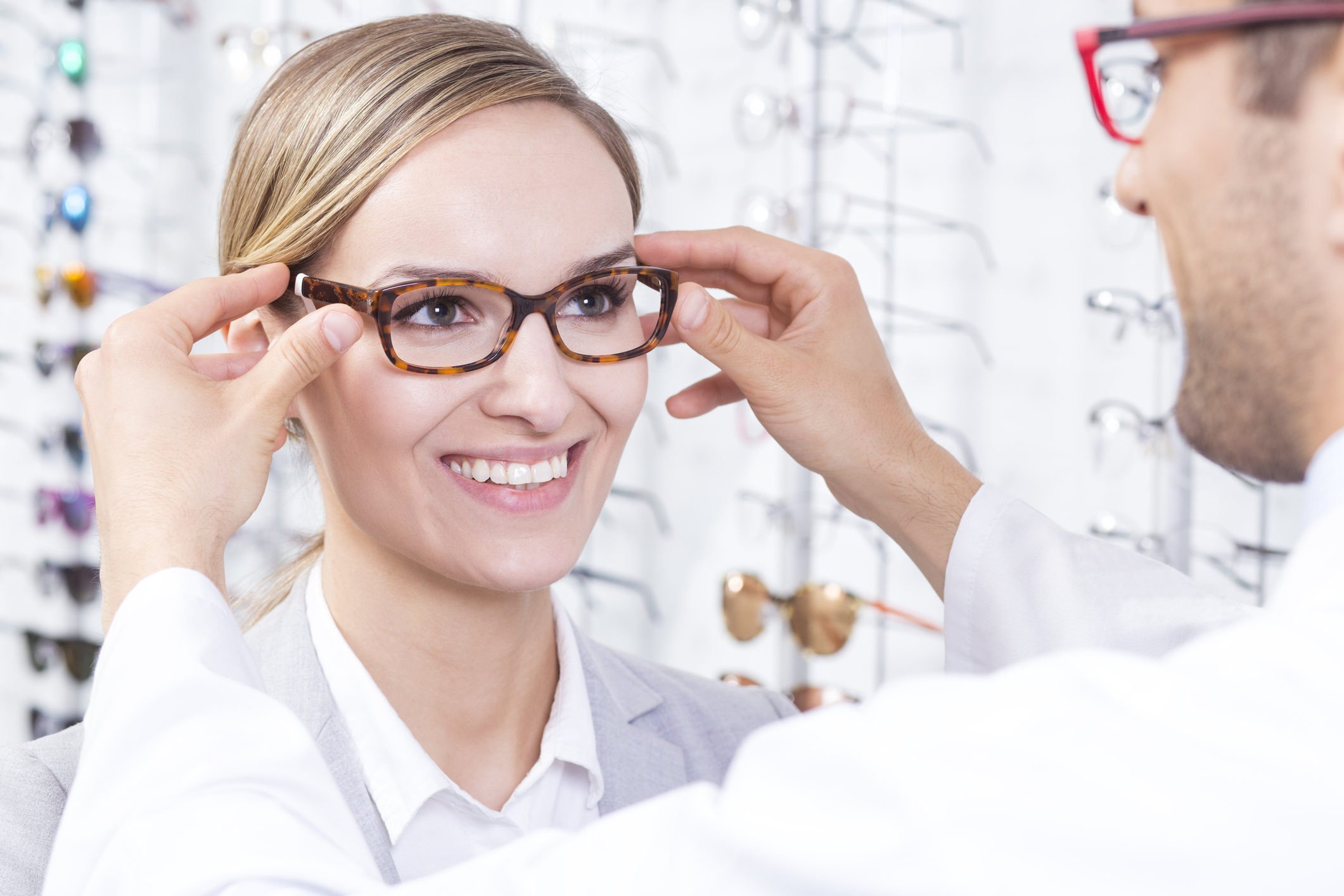 Fitting and adjusting ophthalmic frames.