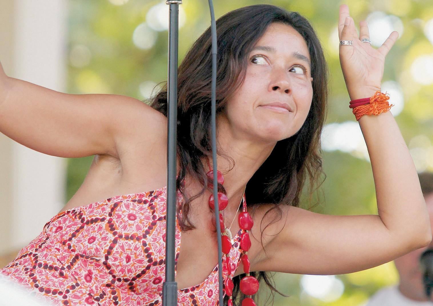 Cover of Thousand Oaks Acorn newspaper. Performing with Sambaguru at Gardens of The World in 2010.