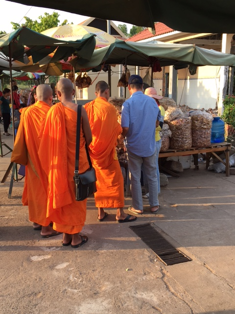 A roadside market, where monks and lawyers gather to buy snacks.