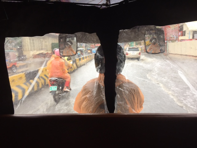 Monsoon rains from inside a tuk tuk. It's dry inside -- every tuk tuk has it's own built-in rain coat that zips down to keep the riders dry.