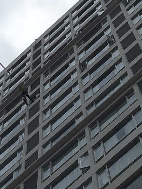 A window washer on the side of a building is not an uncommon sight....