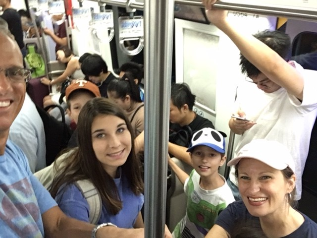 Yes, that's us. And yes, we are absolutely acing our way through the subway system in Beijing.