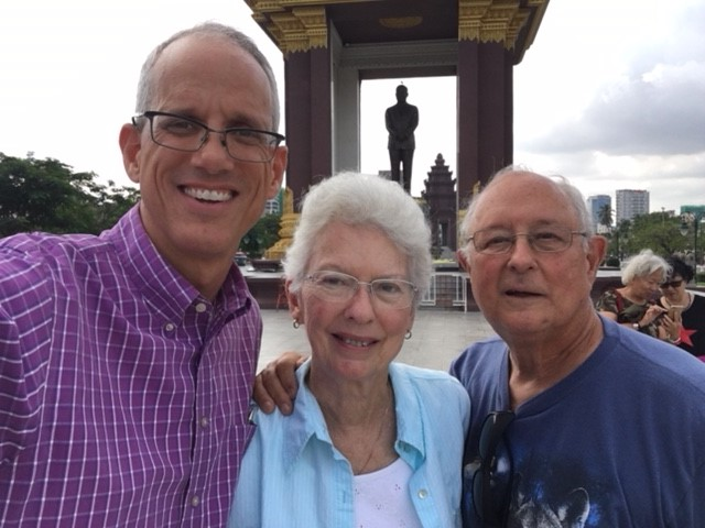 My parents (a/k/a Mimi & Pop) at Independence Monument and the King Norodom SIhanouk statue.