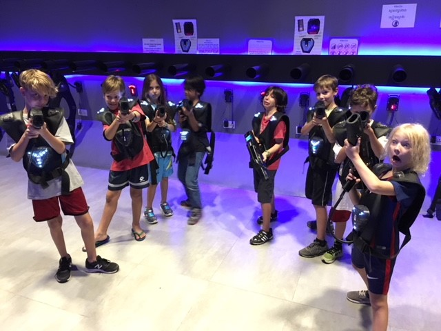 David with his friends, playing laser tag at a Saturday morning birthday party. David is second from the right, with the laser gun hiding his face.