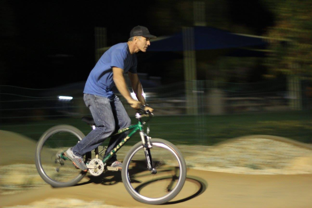 Jamie Lynn, a local contractor who donated his time and equipment to build the park, isn't ashamed of taking a few laps on his daughters bike.