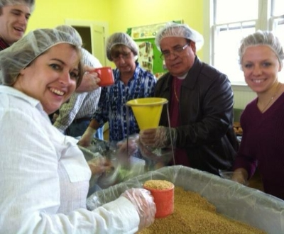 St. John's volunteers package 10,000 meals in our fellowship hall.