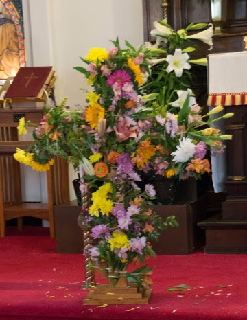 "On Easter Sunday our children ""flower the Cross."""