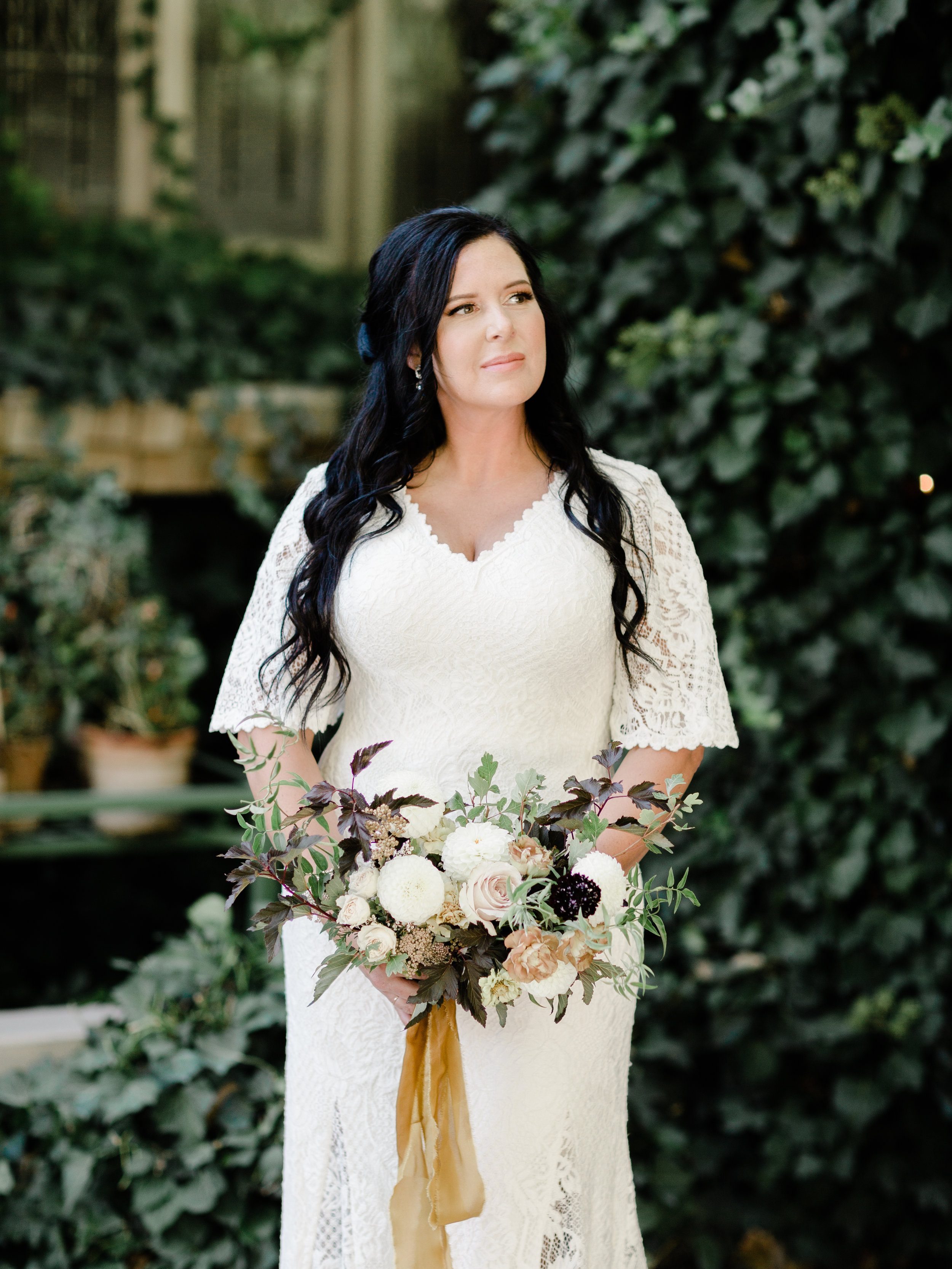 Old world inspired bridal bouquet for this early Autumn wedding with dark foliages and tied with a soft golden ribbon