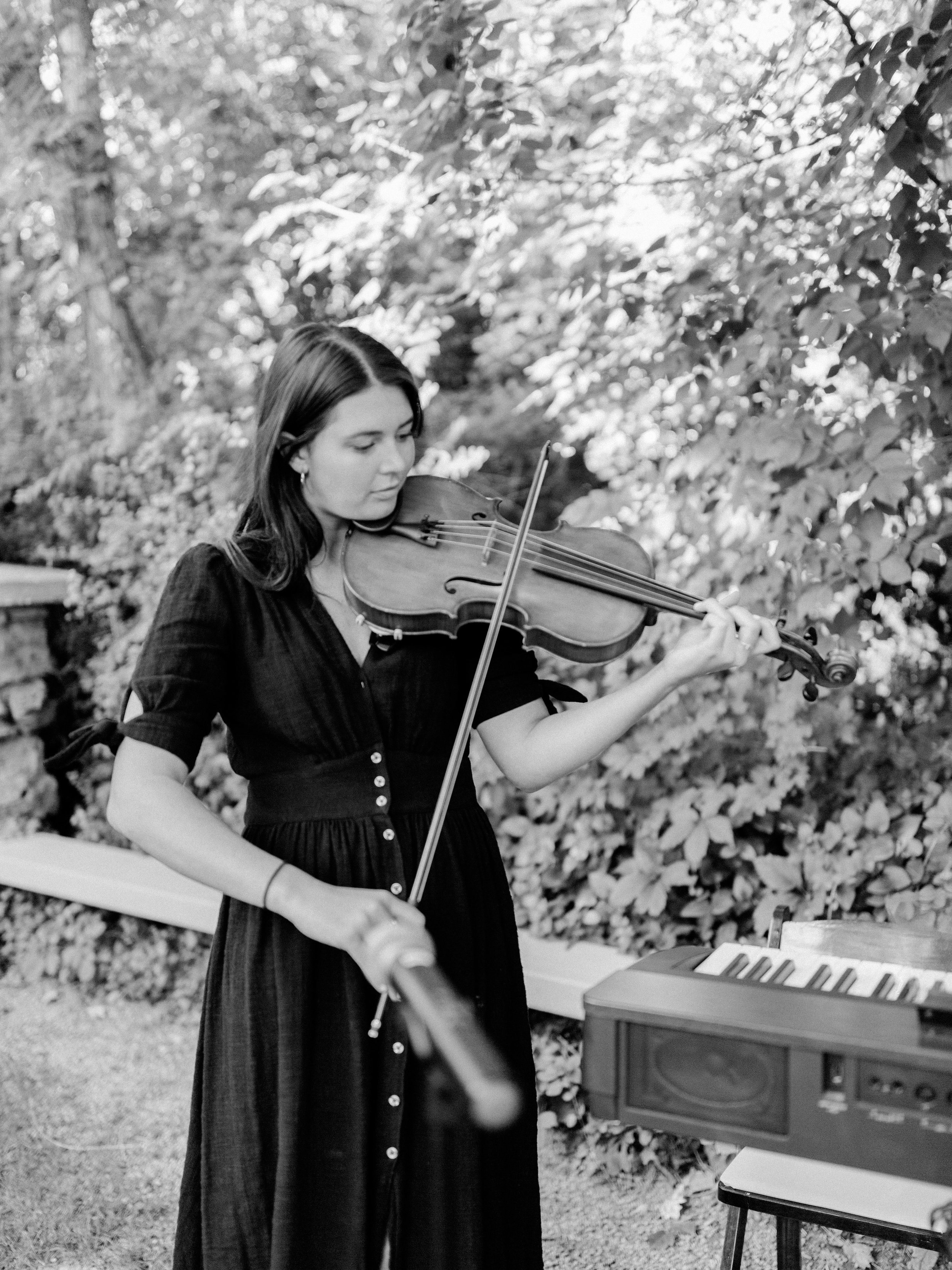 Ceremony ideas for an intimate wedding atmosphere with a violinist playing music