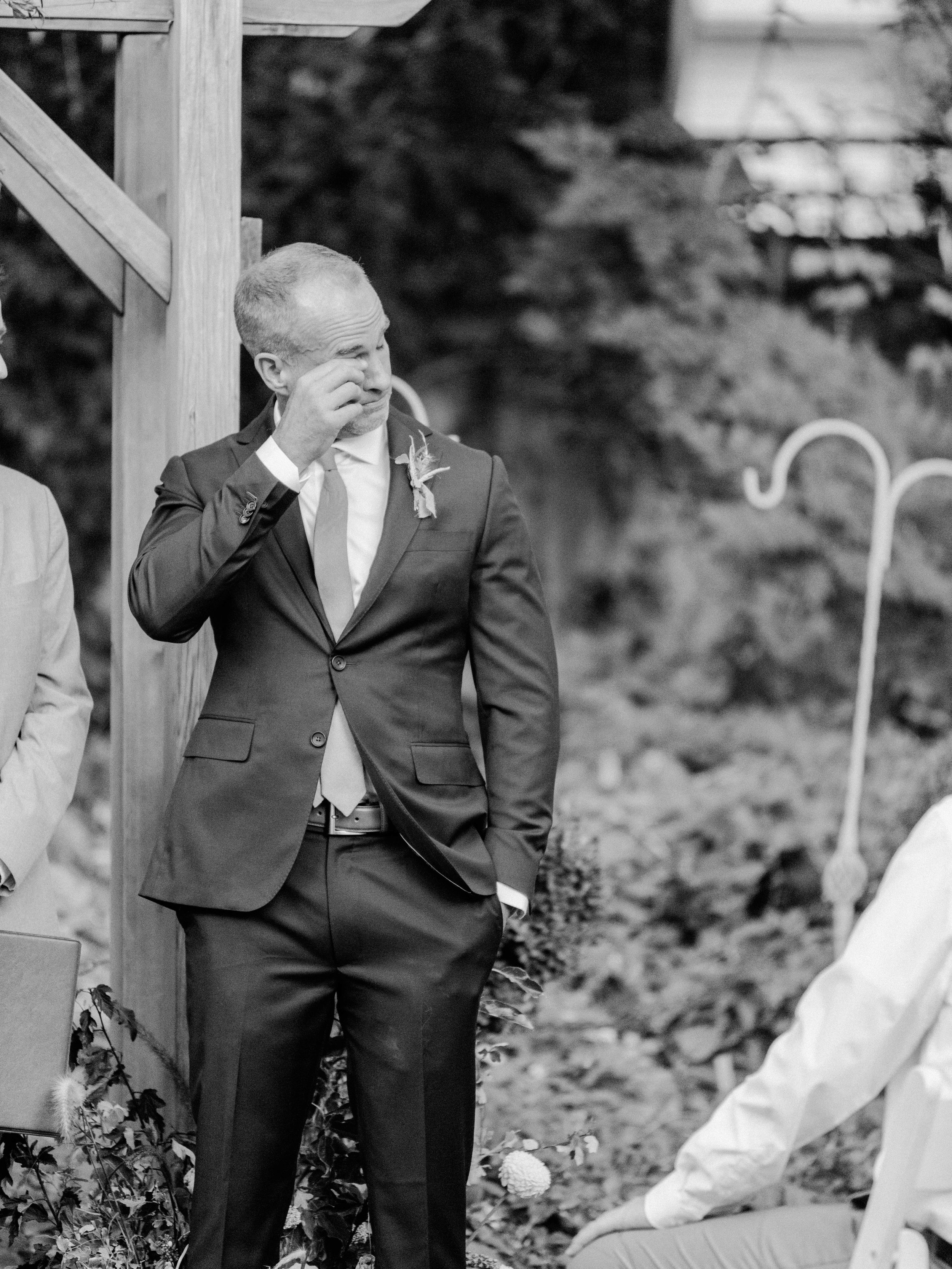 The sweetest groom seeing his bride walk down the aisle at The Bungalow in Utah