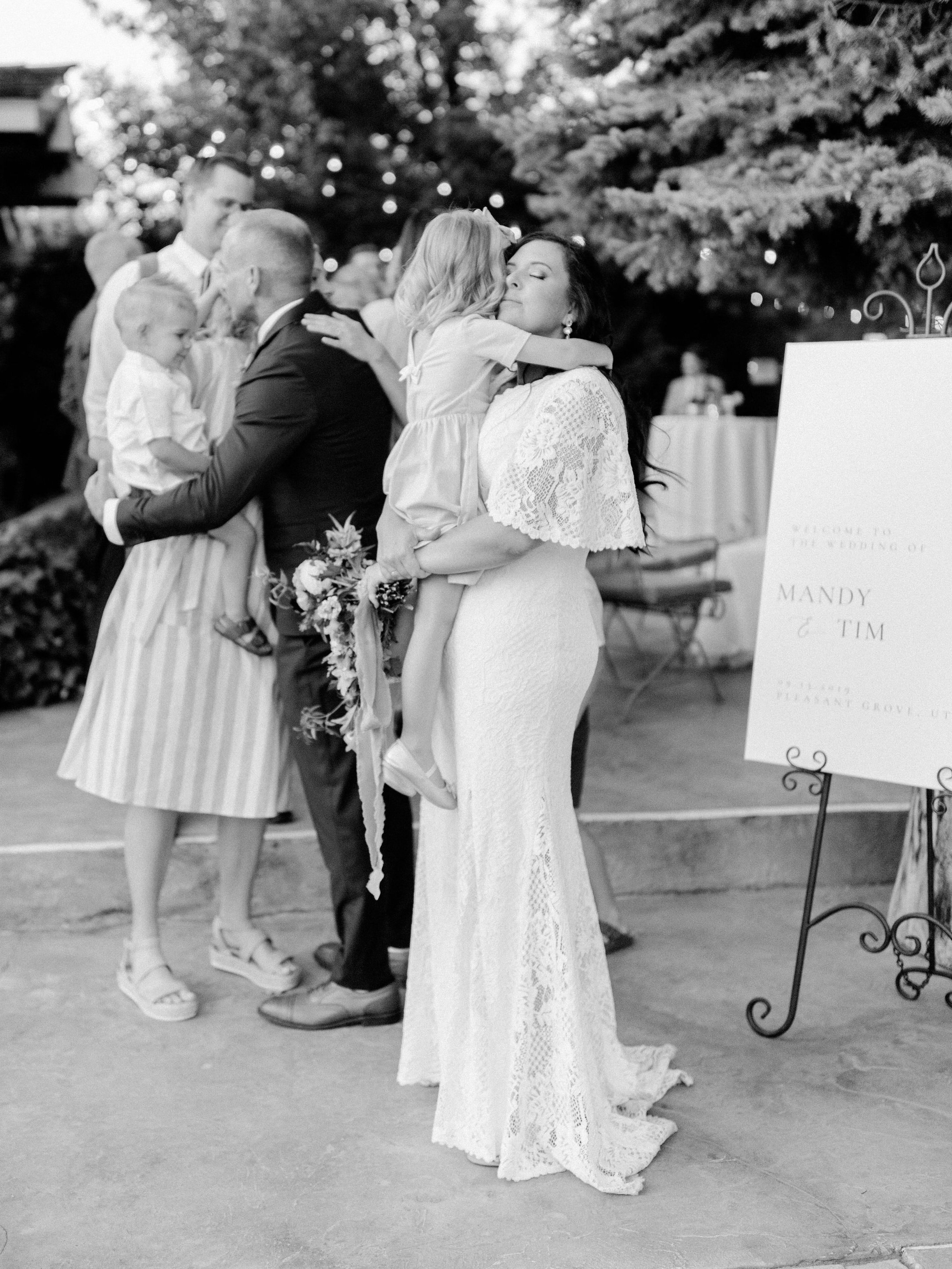 The sweetest family embrace at this intimate al fresco wedding