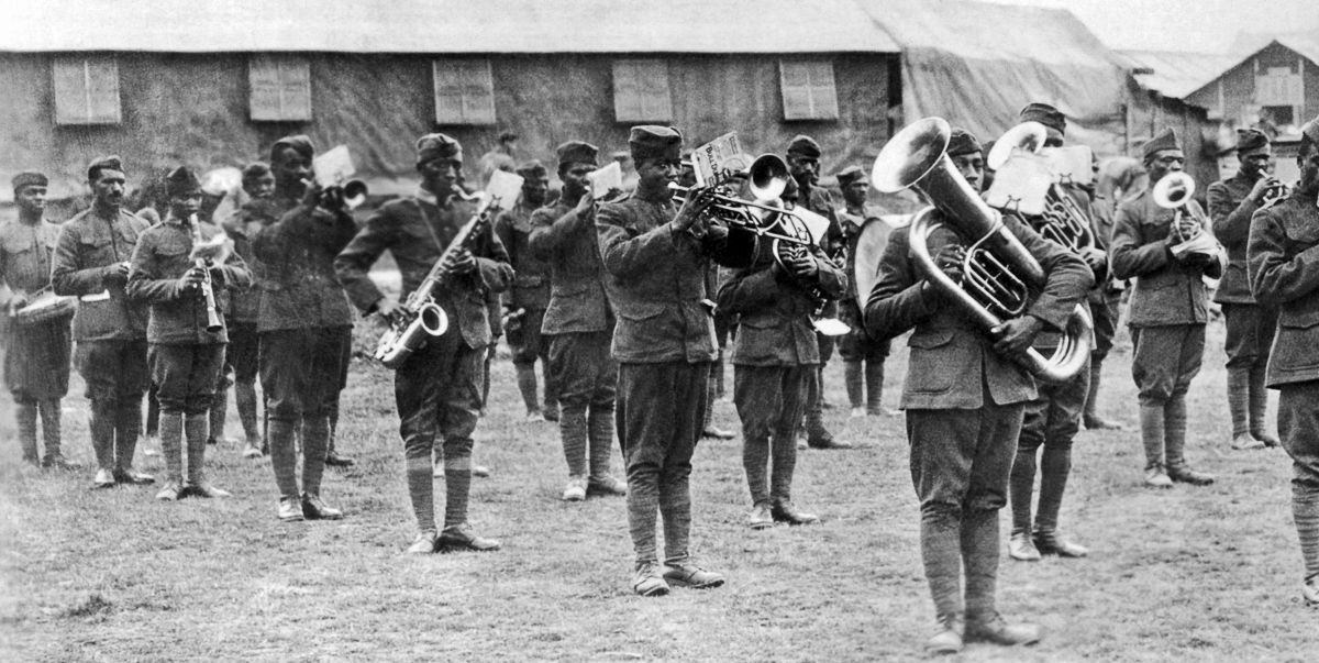 1918: Members of the 369th Infantry band perform under the direction of Lt. James Reese Europe in France.  Courtesy of the Underwood Archives.
