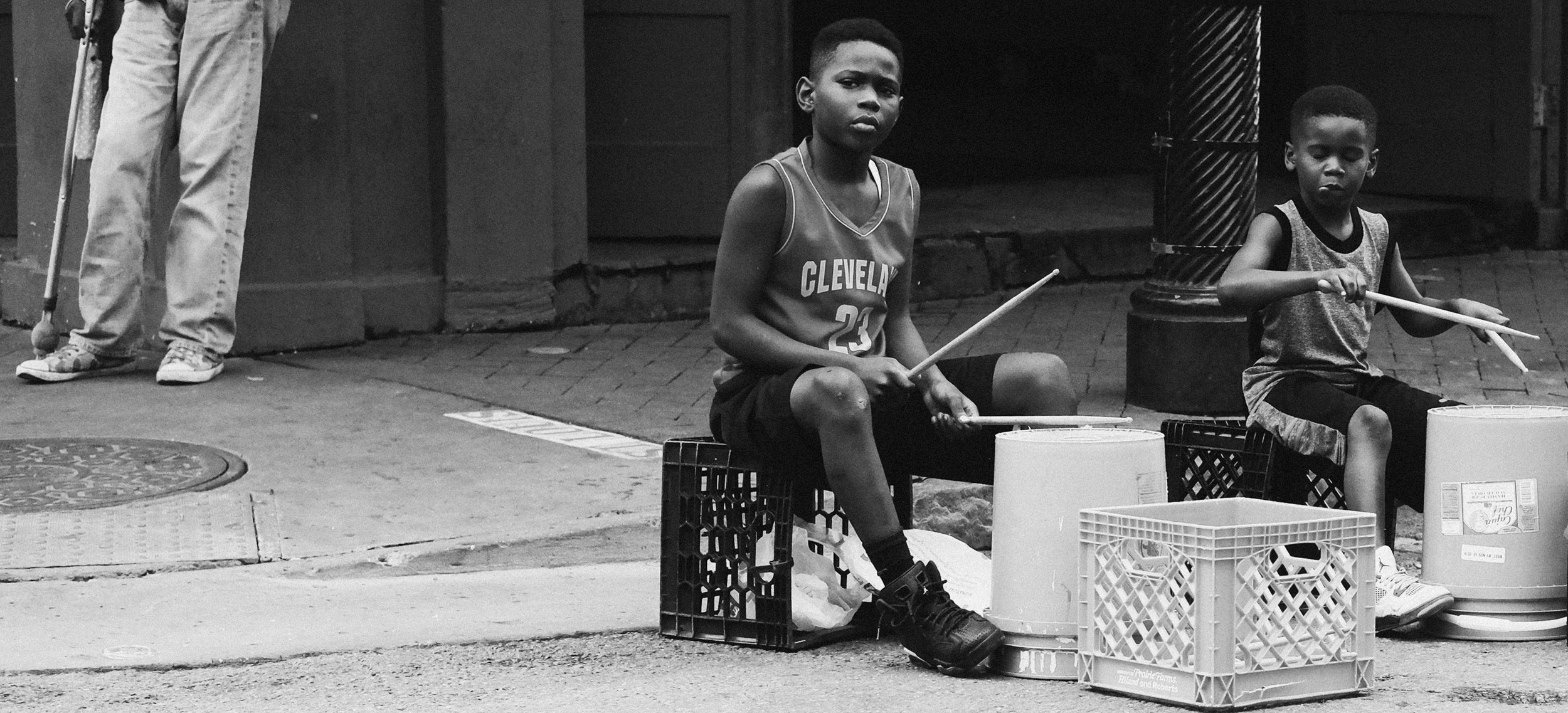 Two young children performing on the streets of the French Quarter, New Orleans, photo by Anthony Scarlati Photography.
