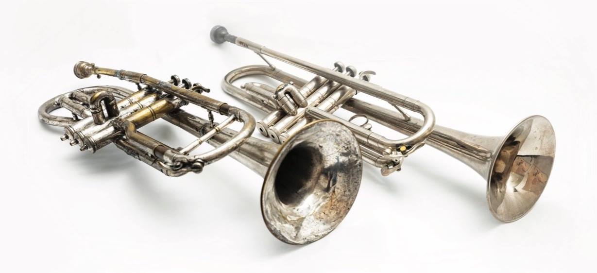Louis Armstrong's first cornet next to Dave Bartholomew's trumpet, by Eric Waters for 64 Parishes / The Louisiana Endowment for the Humanities.