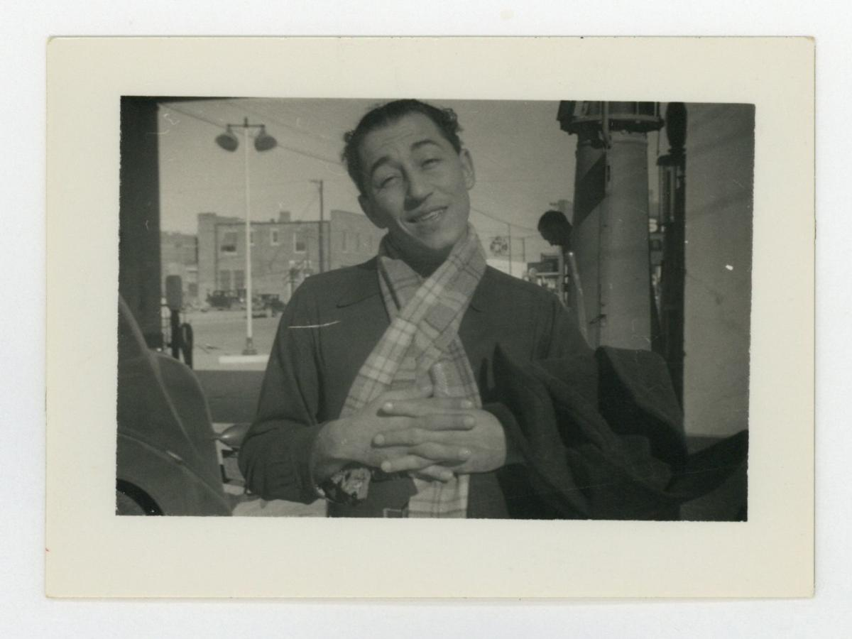 Image: A young Louis Prima poses in a scarf in this undated photo. Prima was born in 1910. Courtesy of the Hogan Jazz Archive.
