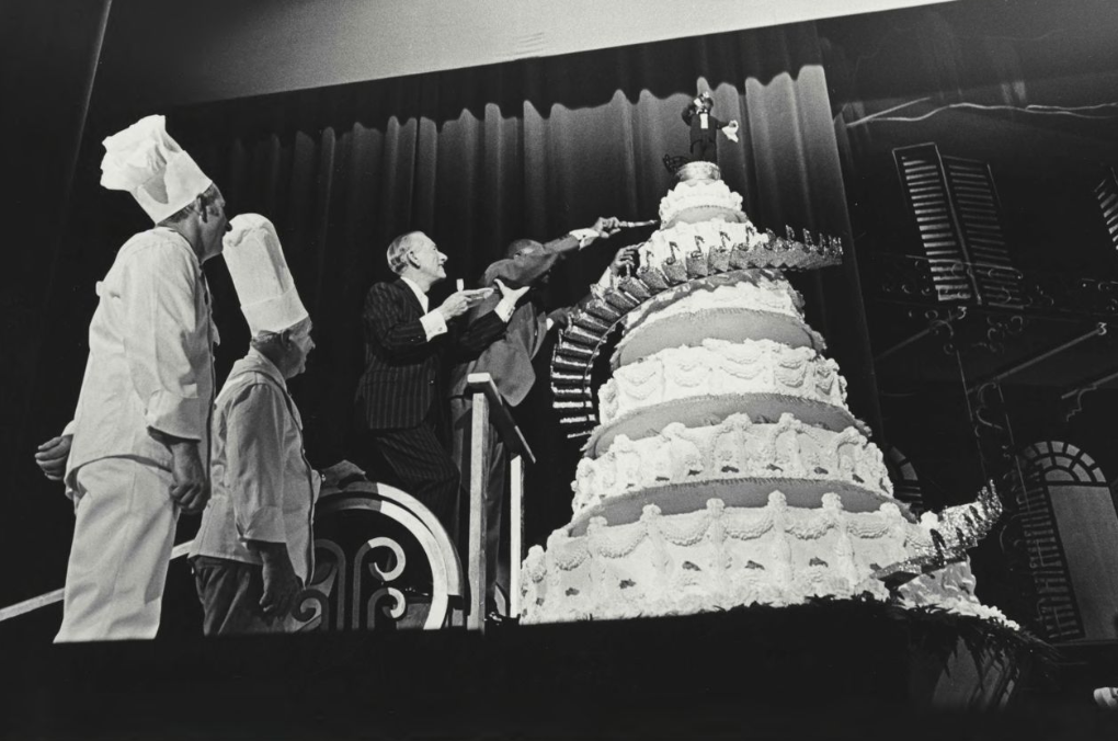Louis Armstrong cuts into an enormous cake at his 70th birthday party, New Orleans Jazz Museum Collection