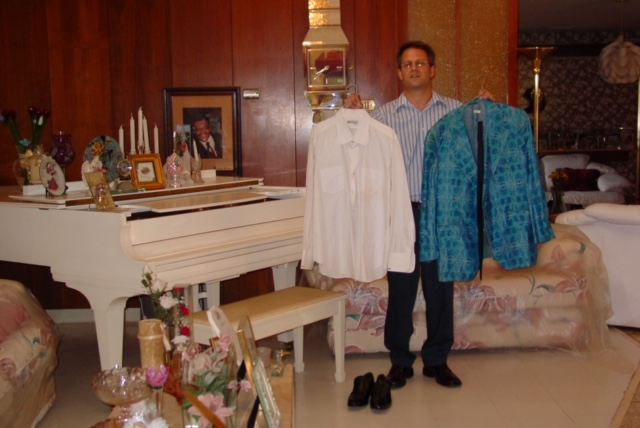 Jazz Museum Director Greg Lambousy at Fats Domino's house with two of Fat's suits and piano just weeks before Hurricane Katrina.