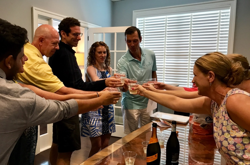 Team gathers for a celebratory toast prior to the 10th Anniversary BBQ celebration