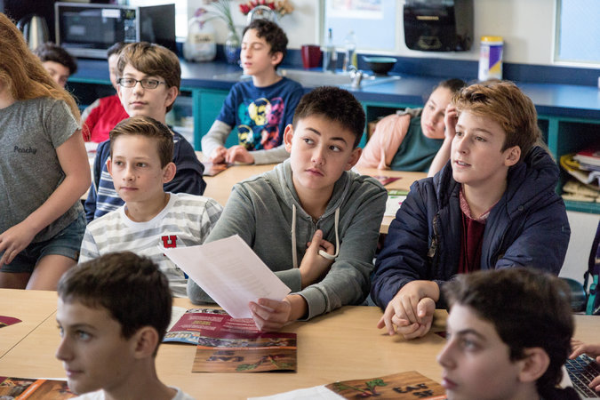 Students at the Brandeis School of San Francisco listening to Ms. Bonini on Wednesday. Charities pitch to the students to request a share of their funding. Credit Jason Henry for The New York Times
