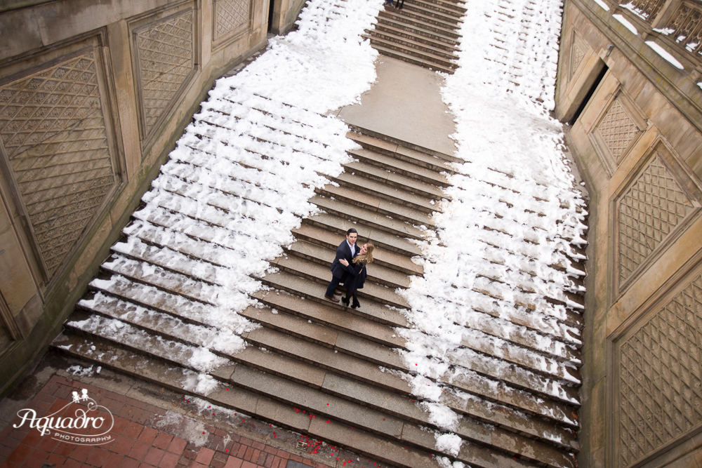 Engaged Couple on the stairs of the Bethesda Terrace