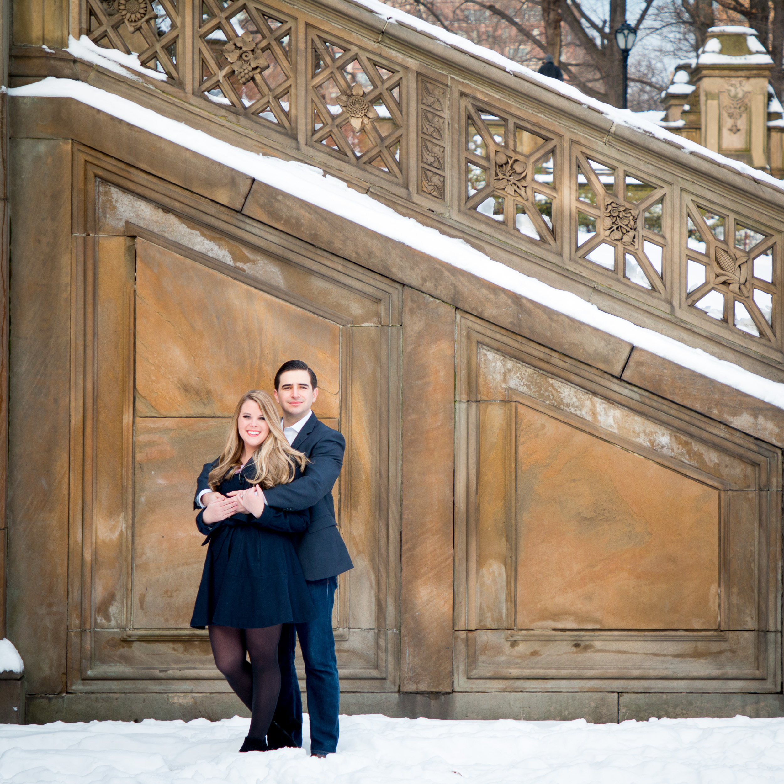 Engaged Couple by snowy Bethesda Terrace stairs