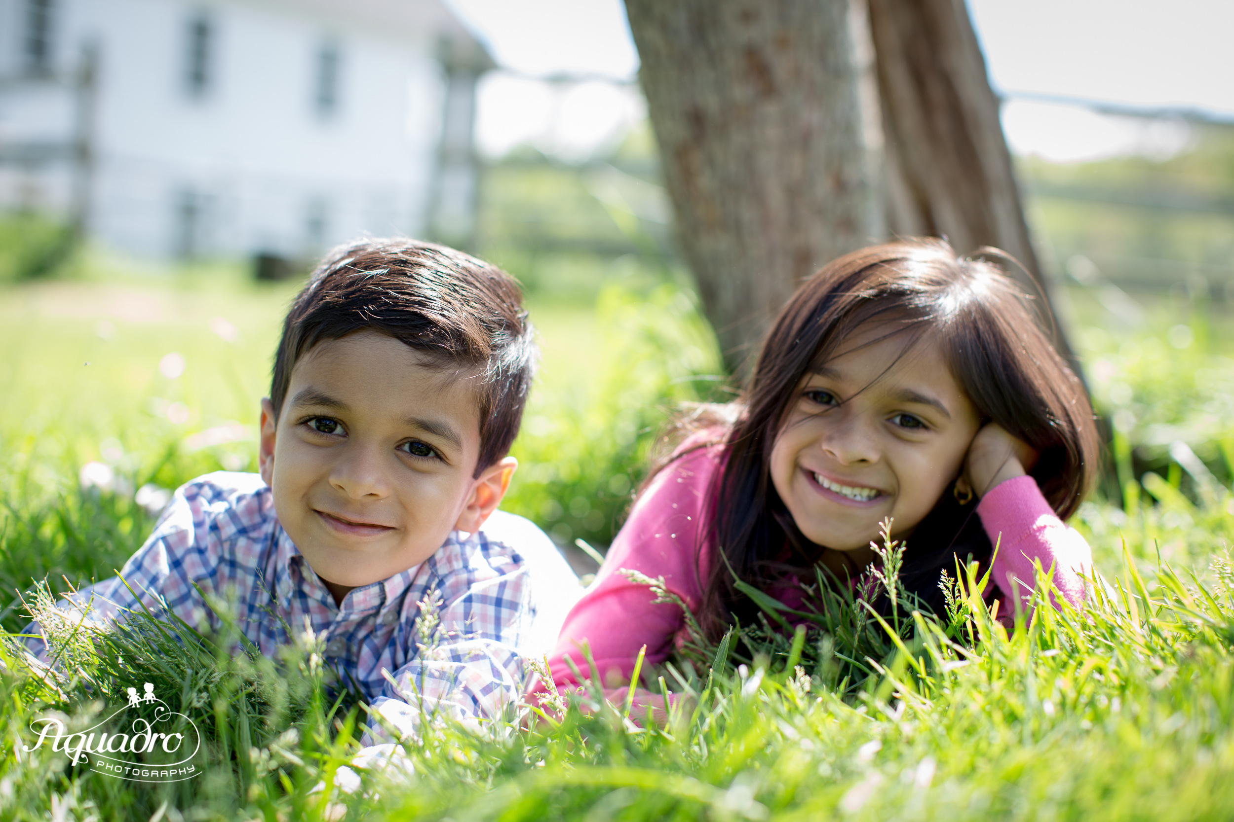 Brother and Sister Lying in Grass