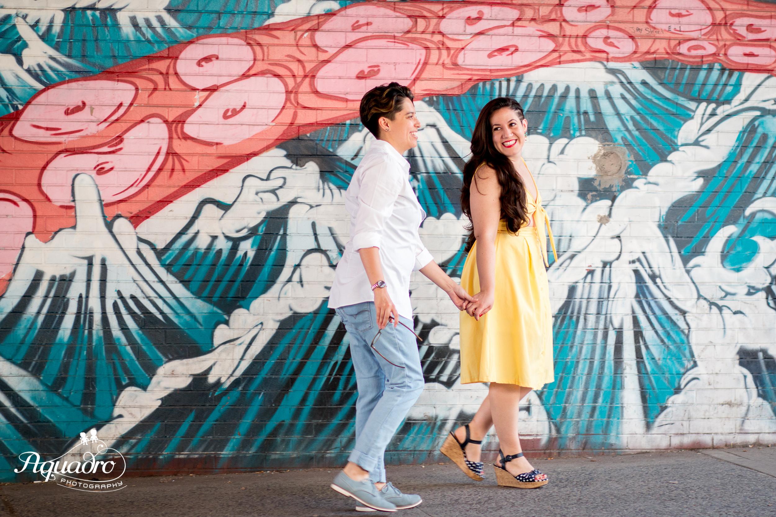 Couple walks hand in hand