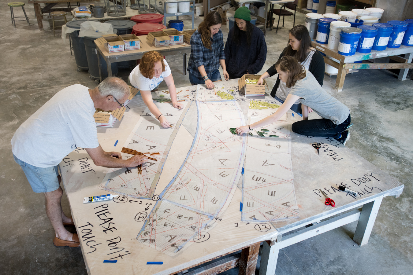 Students working on the transfer of the mosaic design to the mesh blanket.
