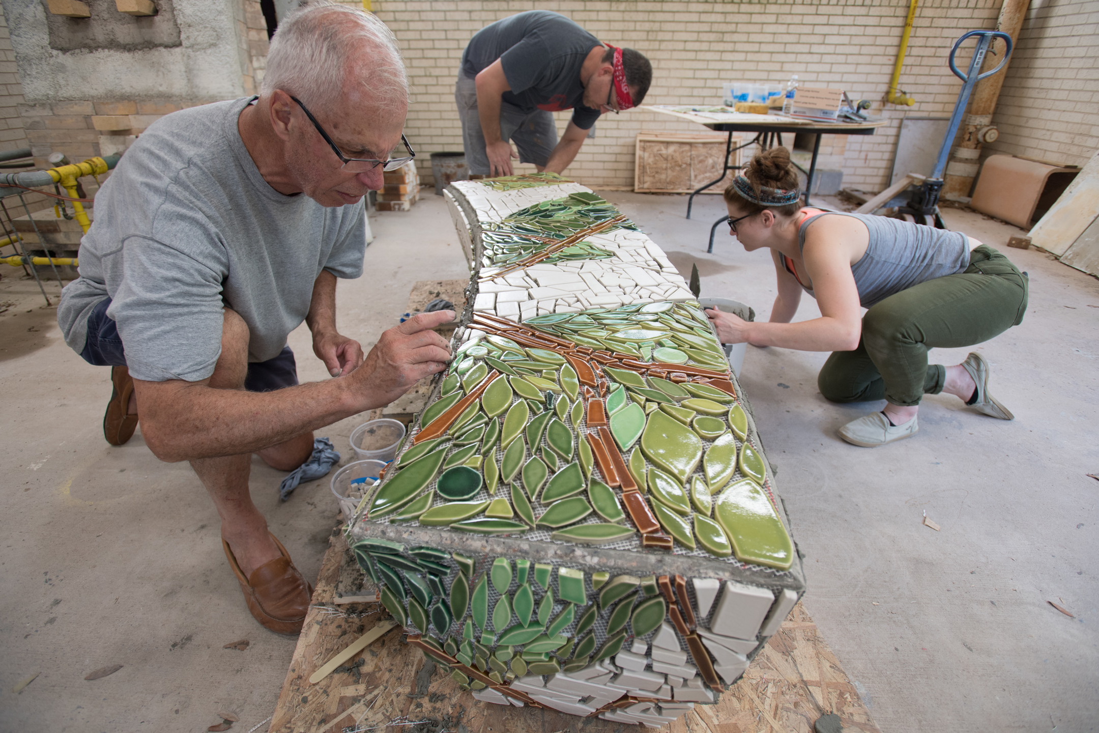 Students and me grouting the tiles.  Photo by Michael Spooneybarger