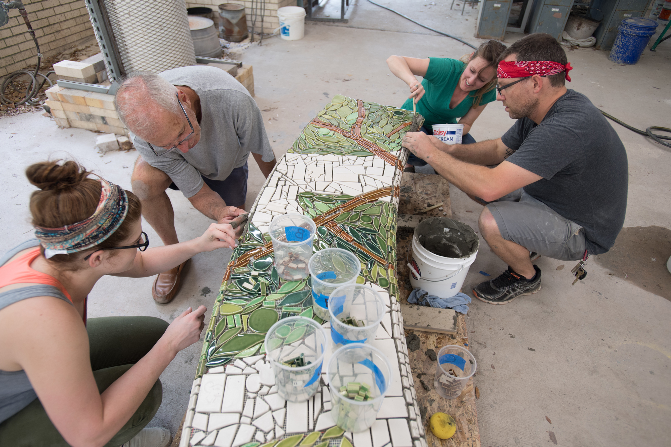 An alternate view of students and me grouting the tiles.  Photo by Michael Spooneybarger