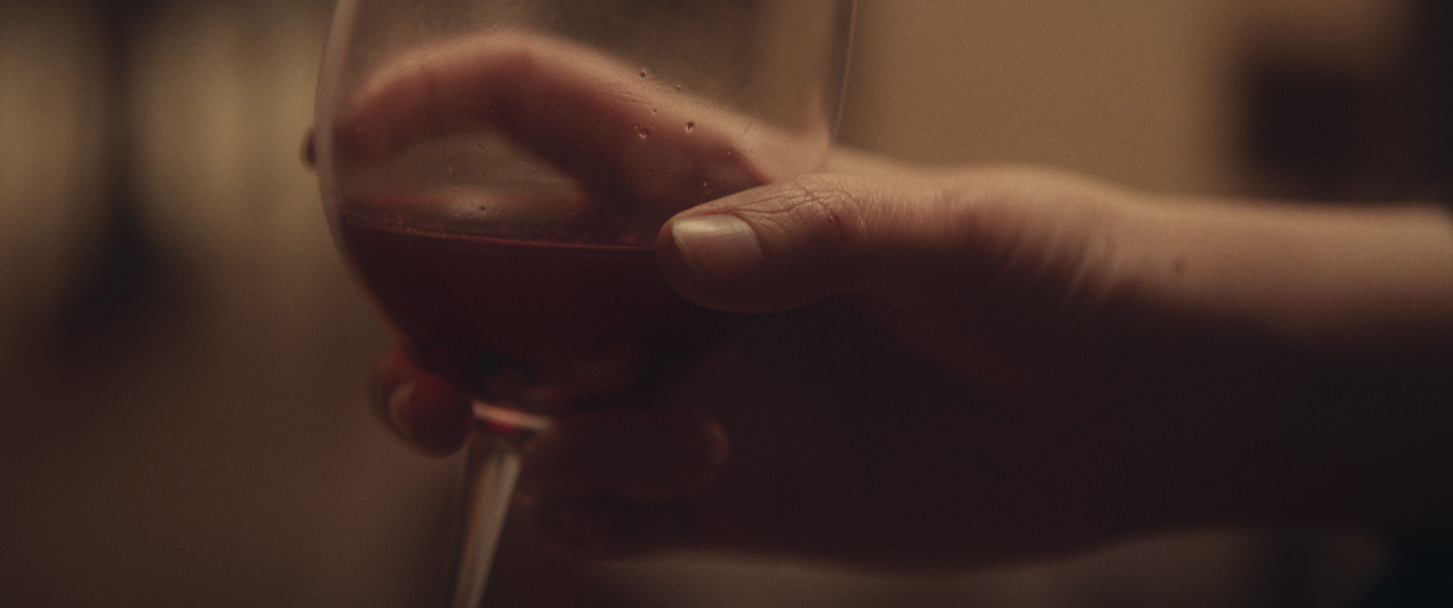 flush - hand with wine.png