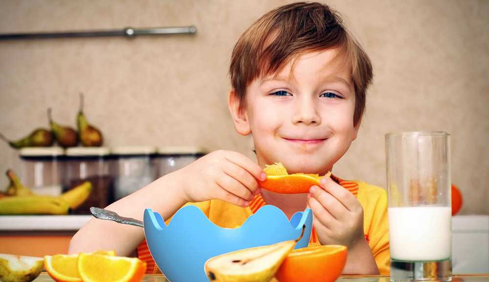 Boy-Eating-Oranger.jpg